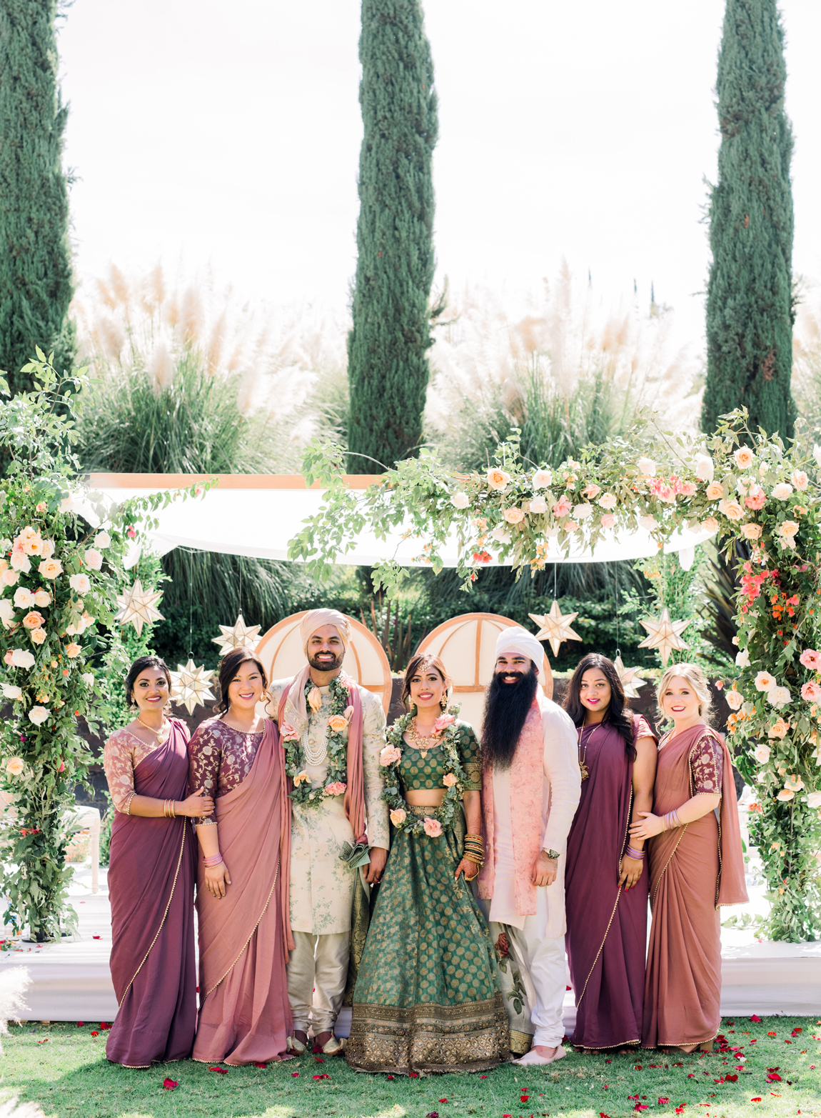 wedding bridal party in coordinating blush and purple attire