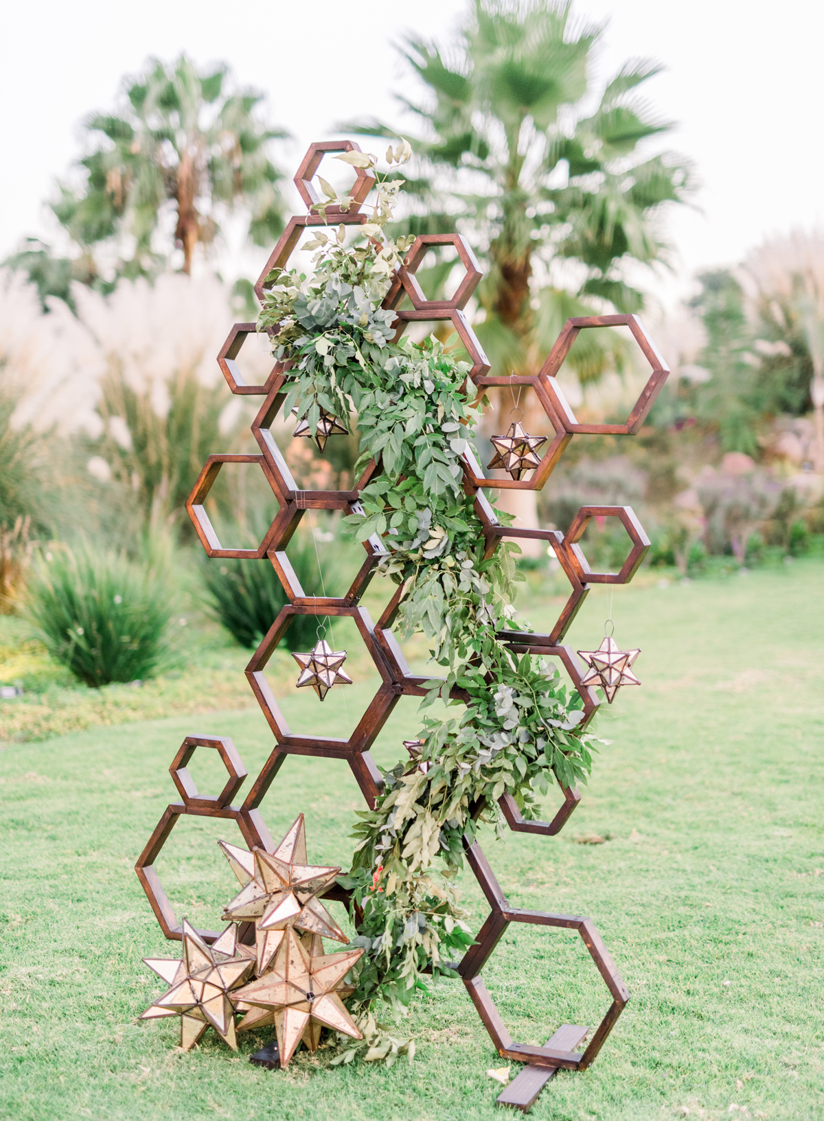 geometric wedding garden decor with mexican stars and greenery accents