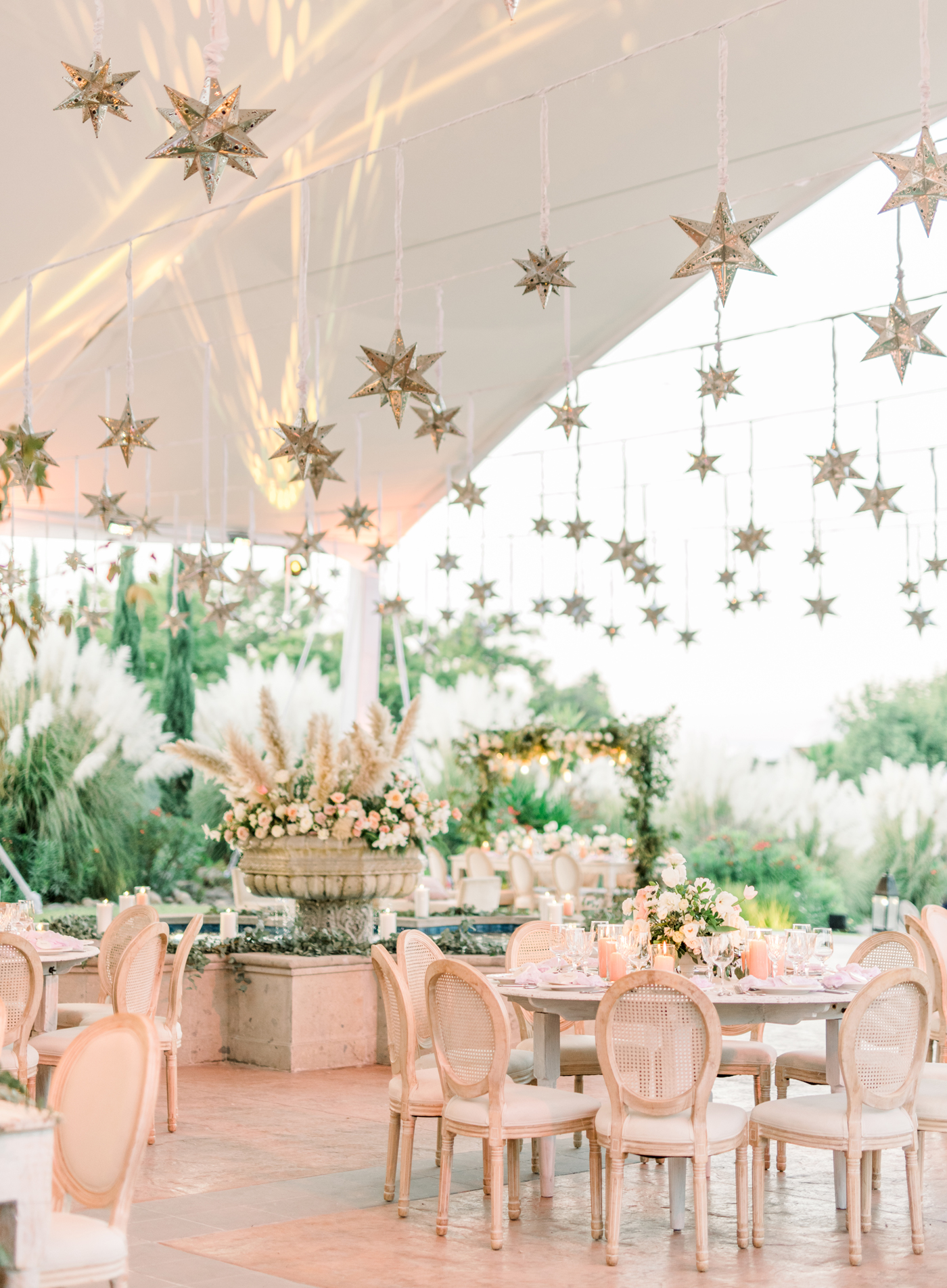 mexican tin stars hanging over reception tables