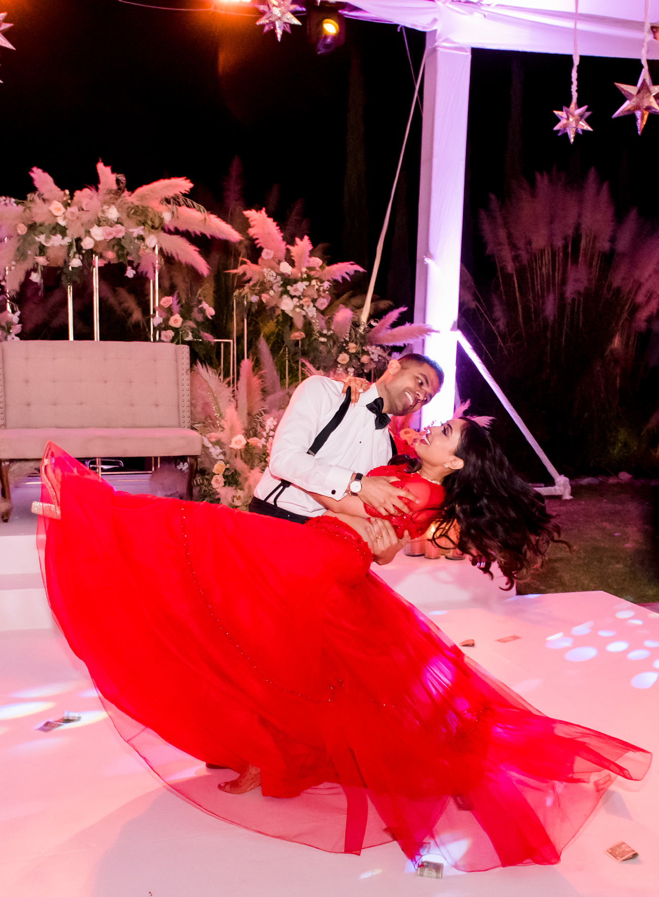 groom dips the bride during first dance