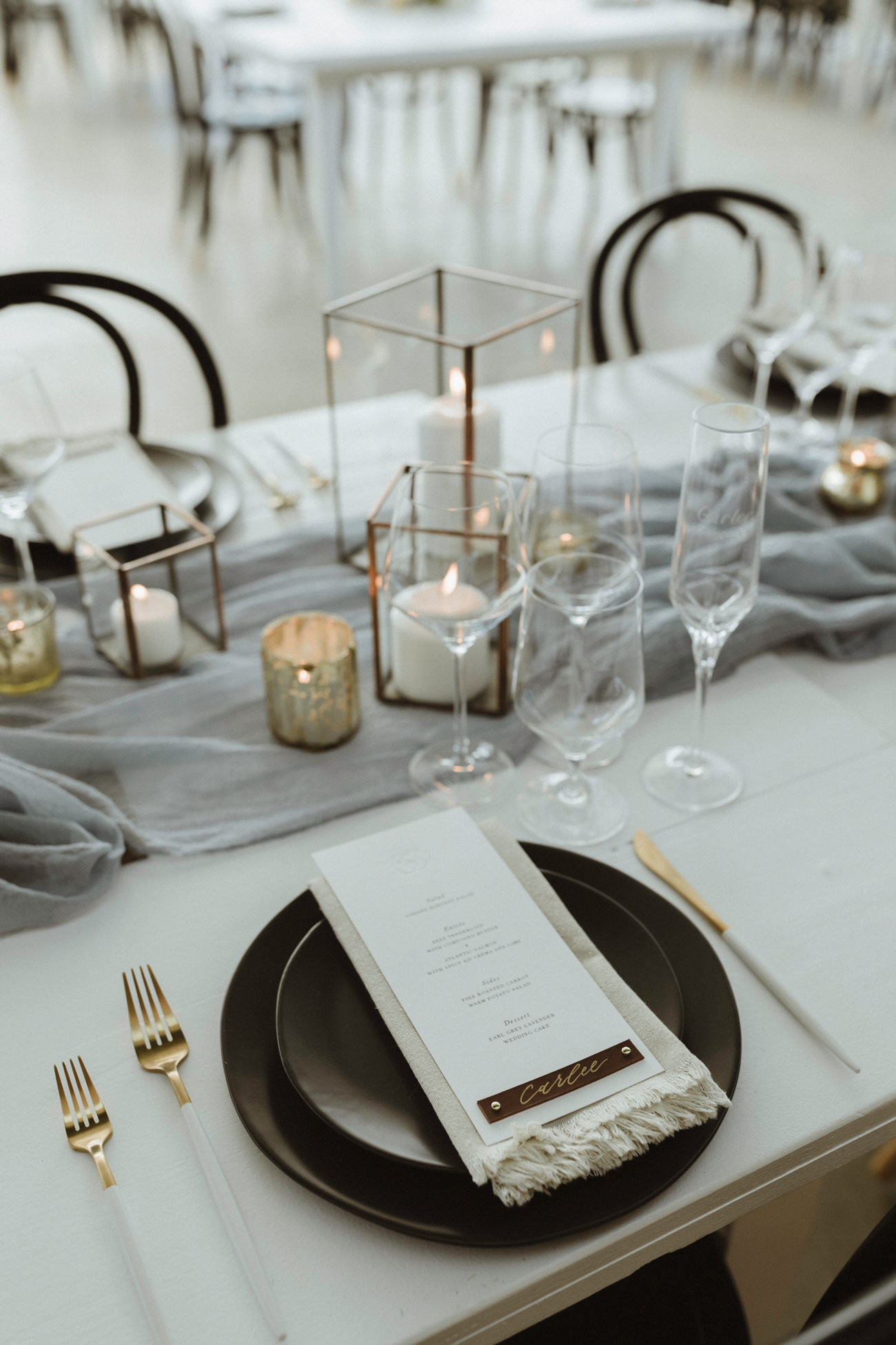 black and white table settings with white and gold tableware