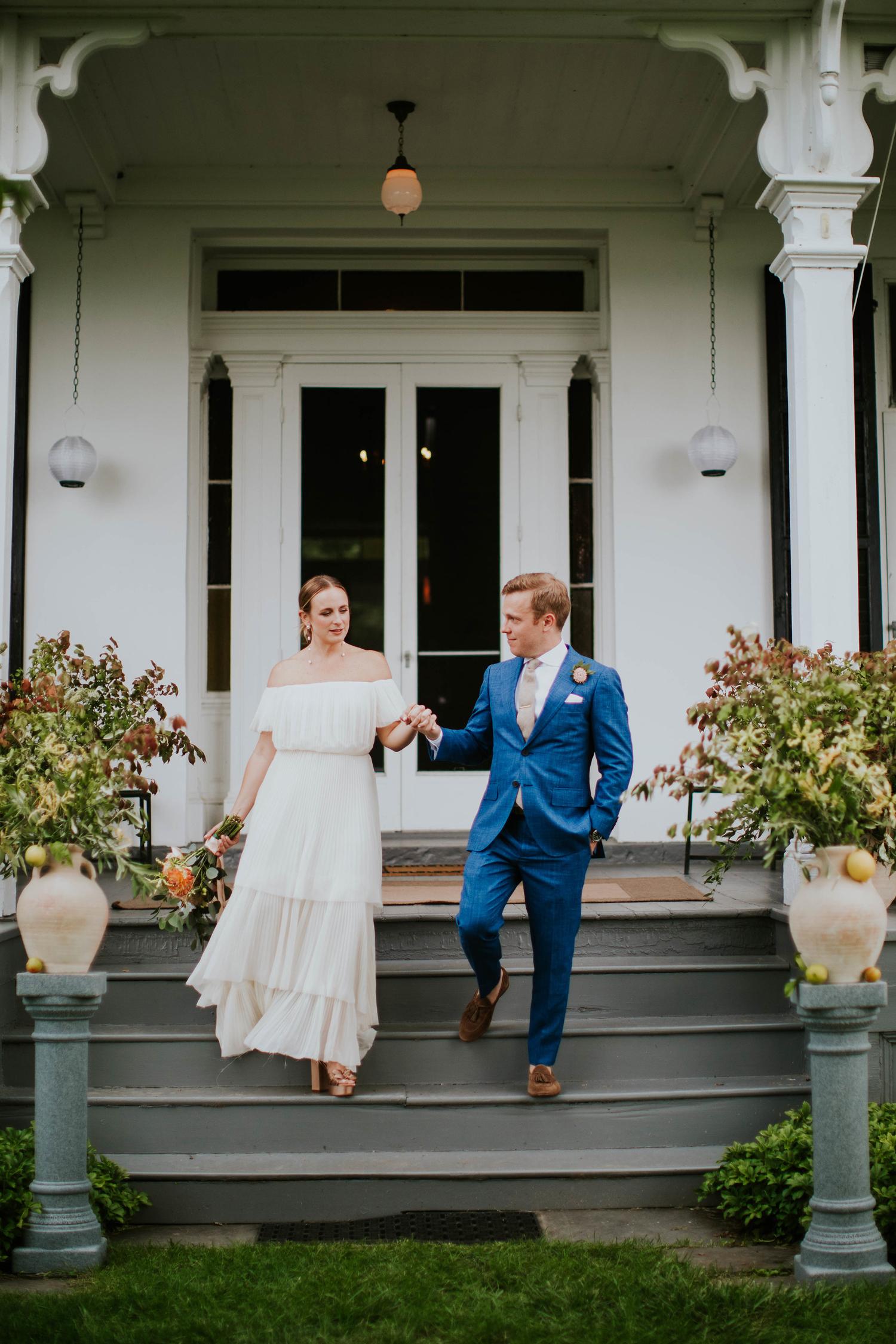 groom escorting bride down stairs