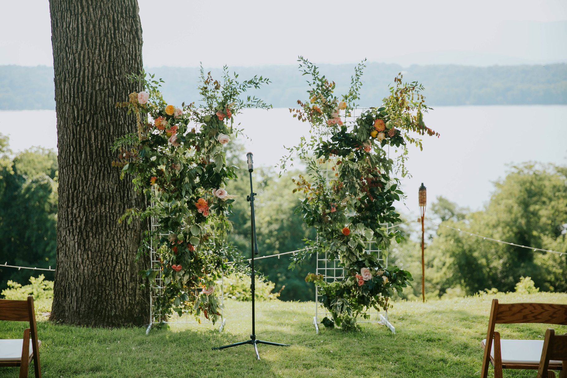 wedding ceremony backdrop flower walls framing hudson river