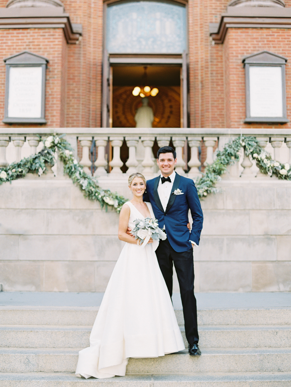 bride and groom standing outside church