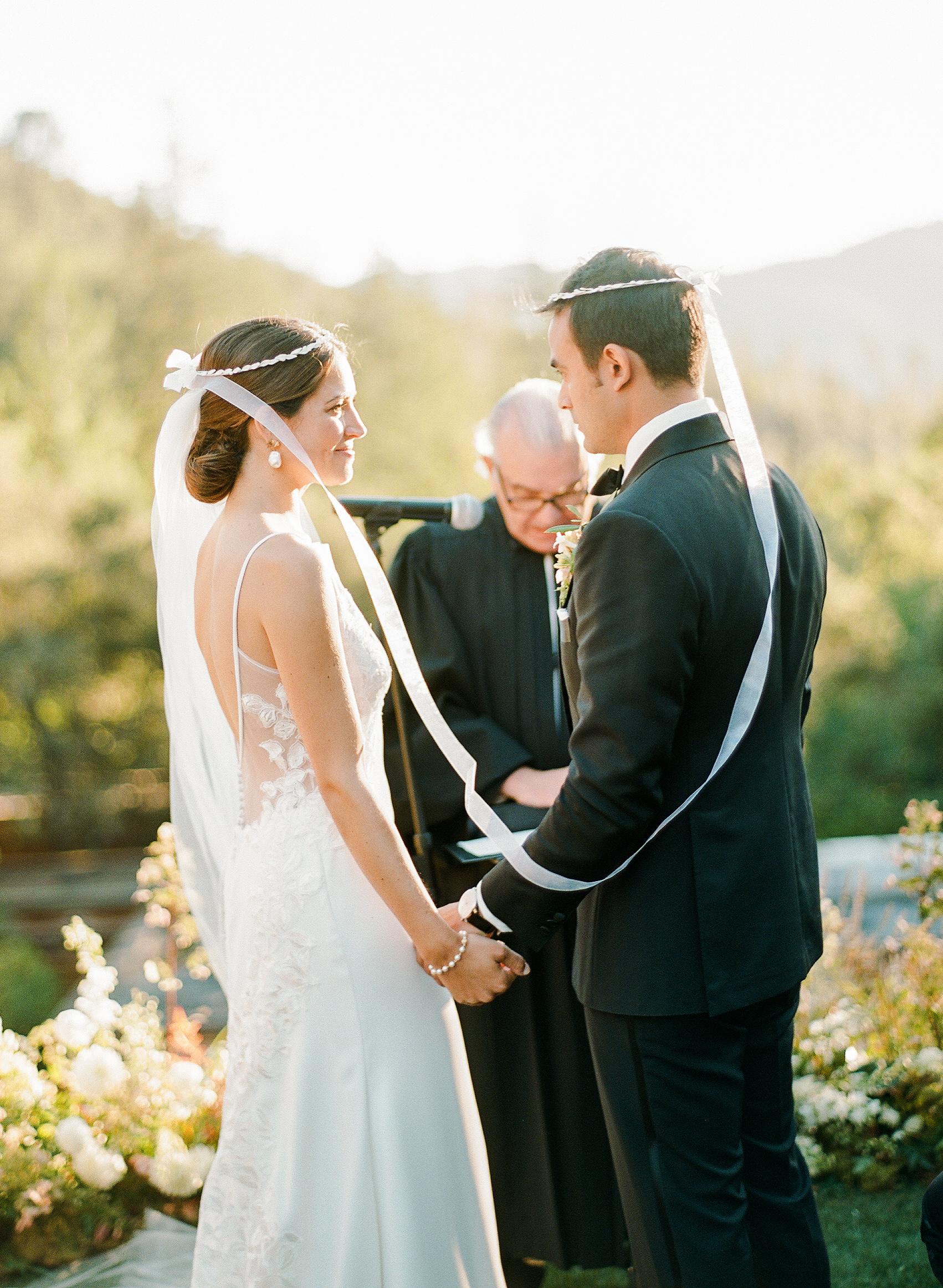 cristina chris wedding ceremony greek crowns couple alter