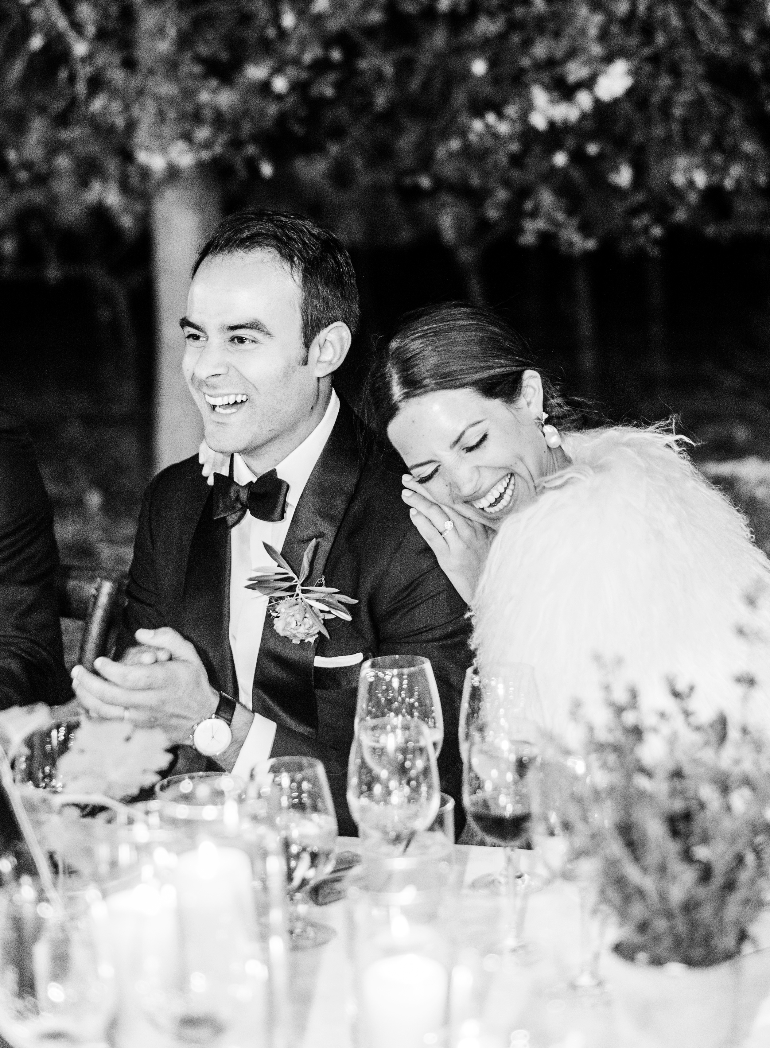 cristina chris wedding couple grinning at reception table black and white