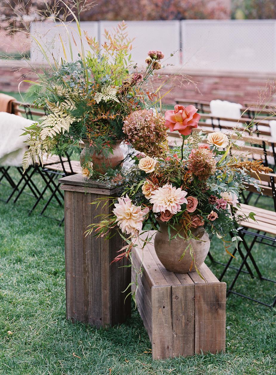 floral arrangements in vases on wooden crates