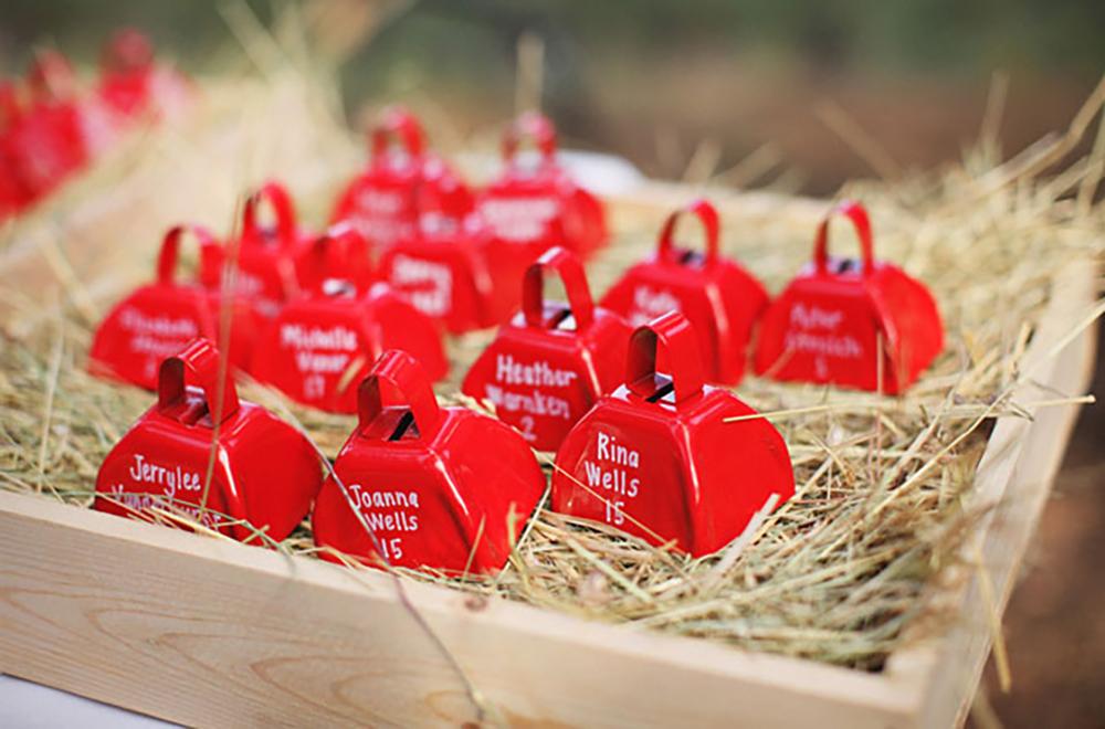 farm themed wedding red cow bells