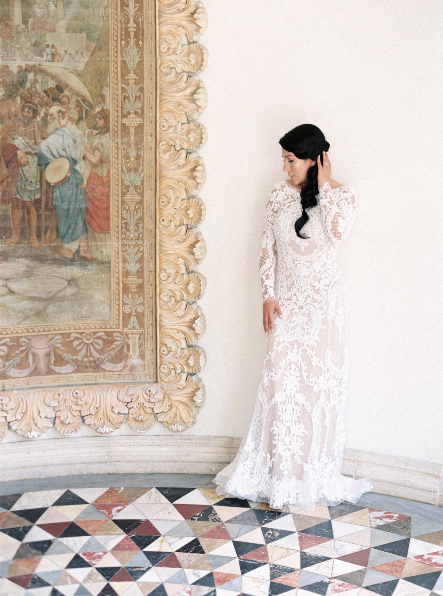 high neckline open back long sleeve ivory lace wedding dress