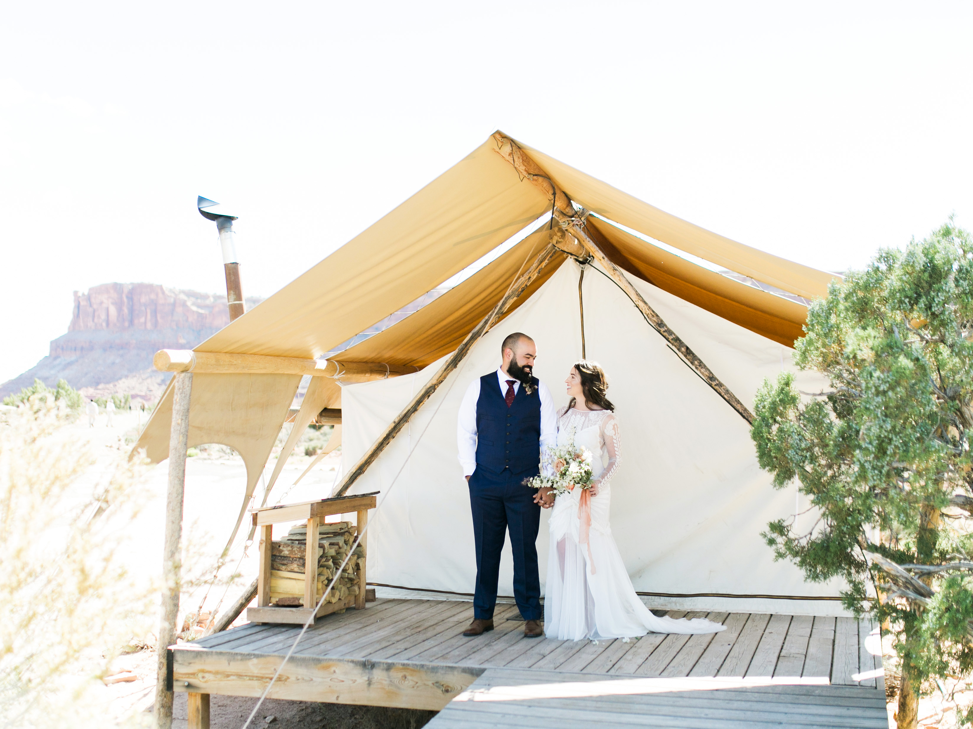 jeanette david wedding couple under tent