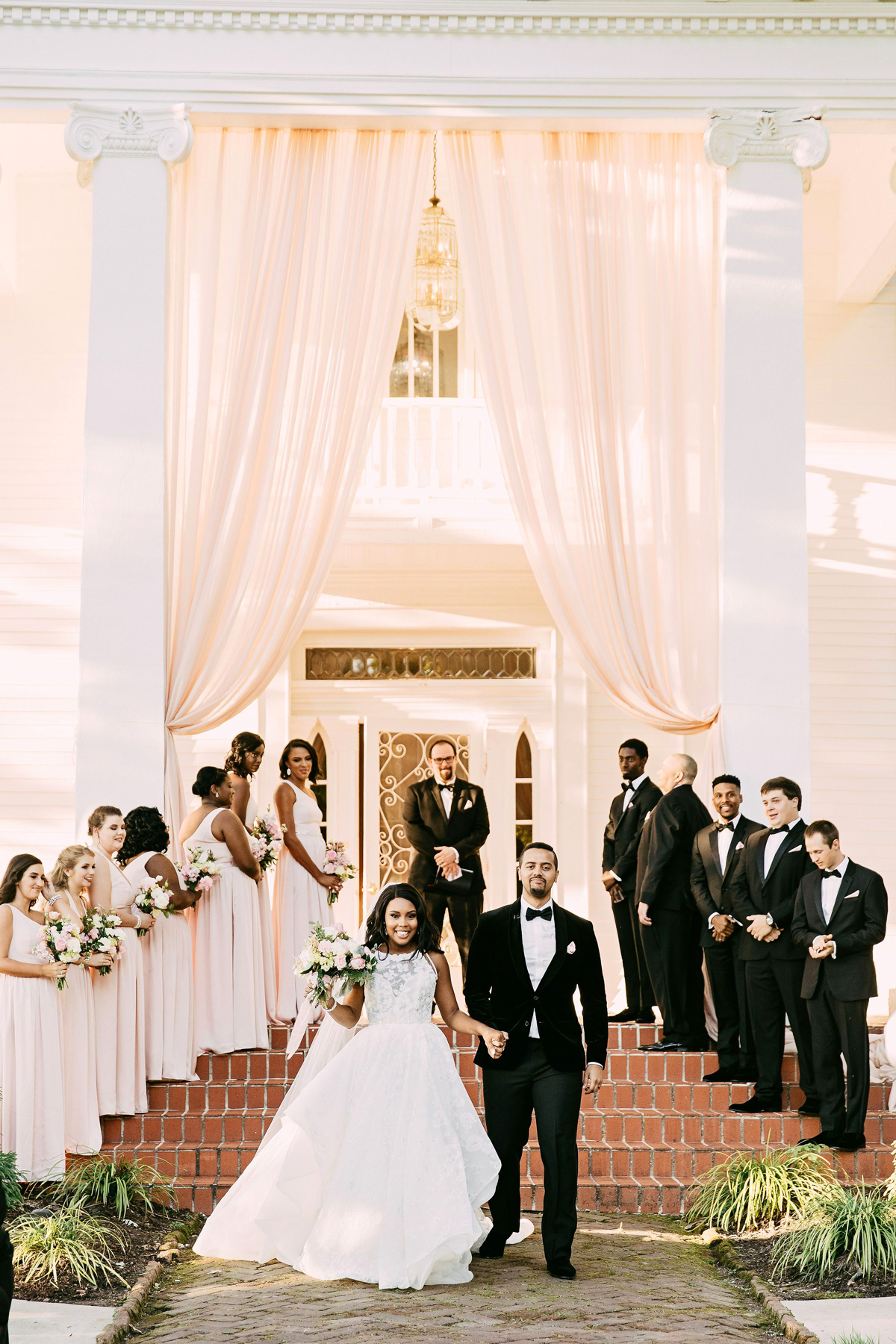 wedding recessional couple walking down steps of porch