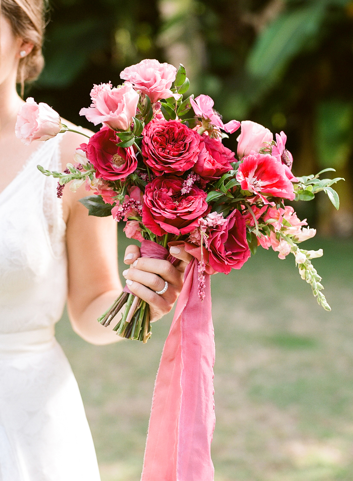 fuchsia, magenta, and coral colored blooms with greenery bouquet