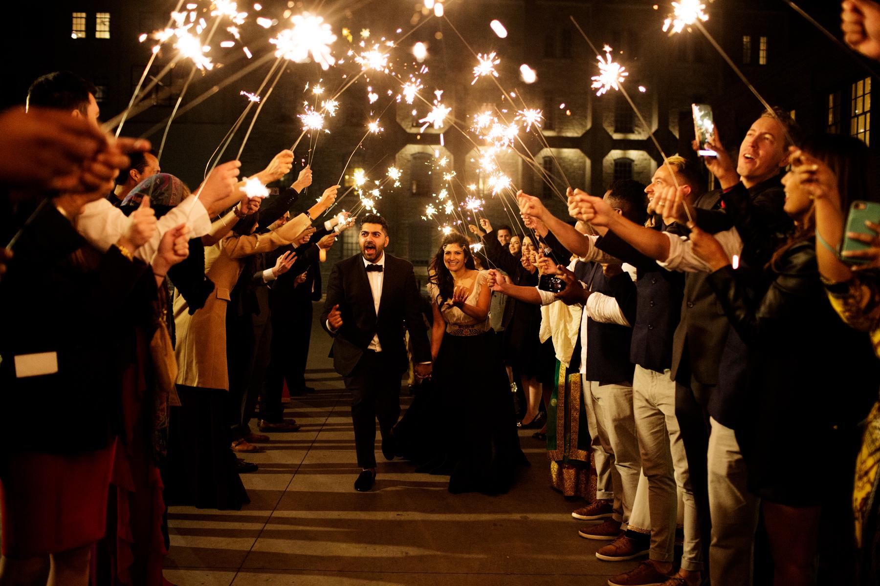 bride and groom sparkler send off after reception