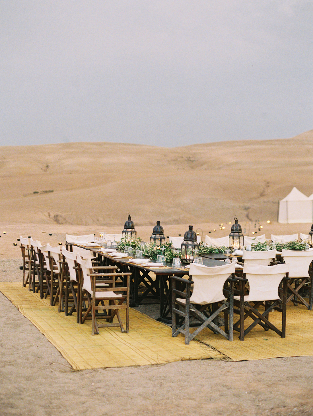 safari style chairs, rugs, and tables with candle and lantern accents
