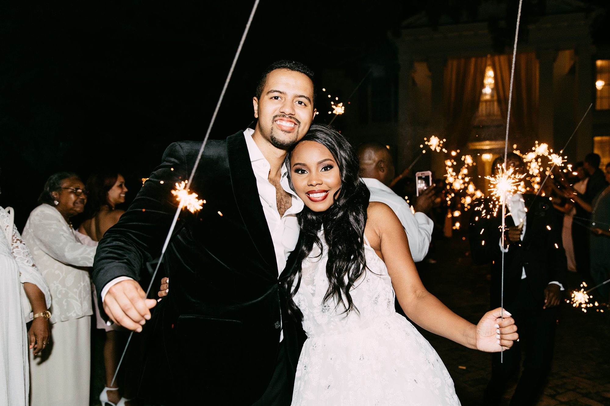 bride and groom holding sparklers