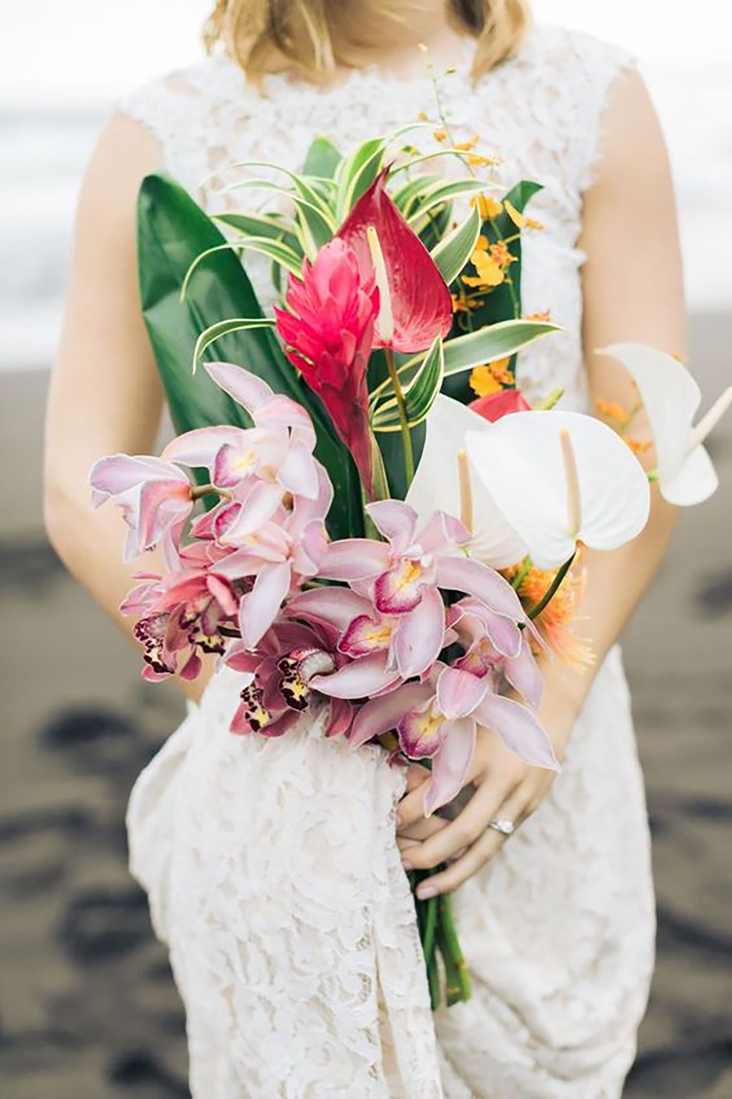 tropical leaf greenery mixed with bold florals bouquet