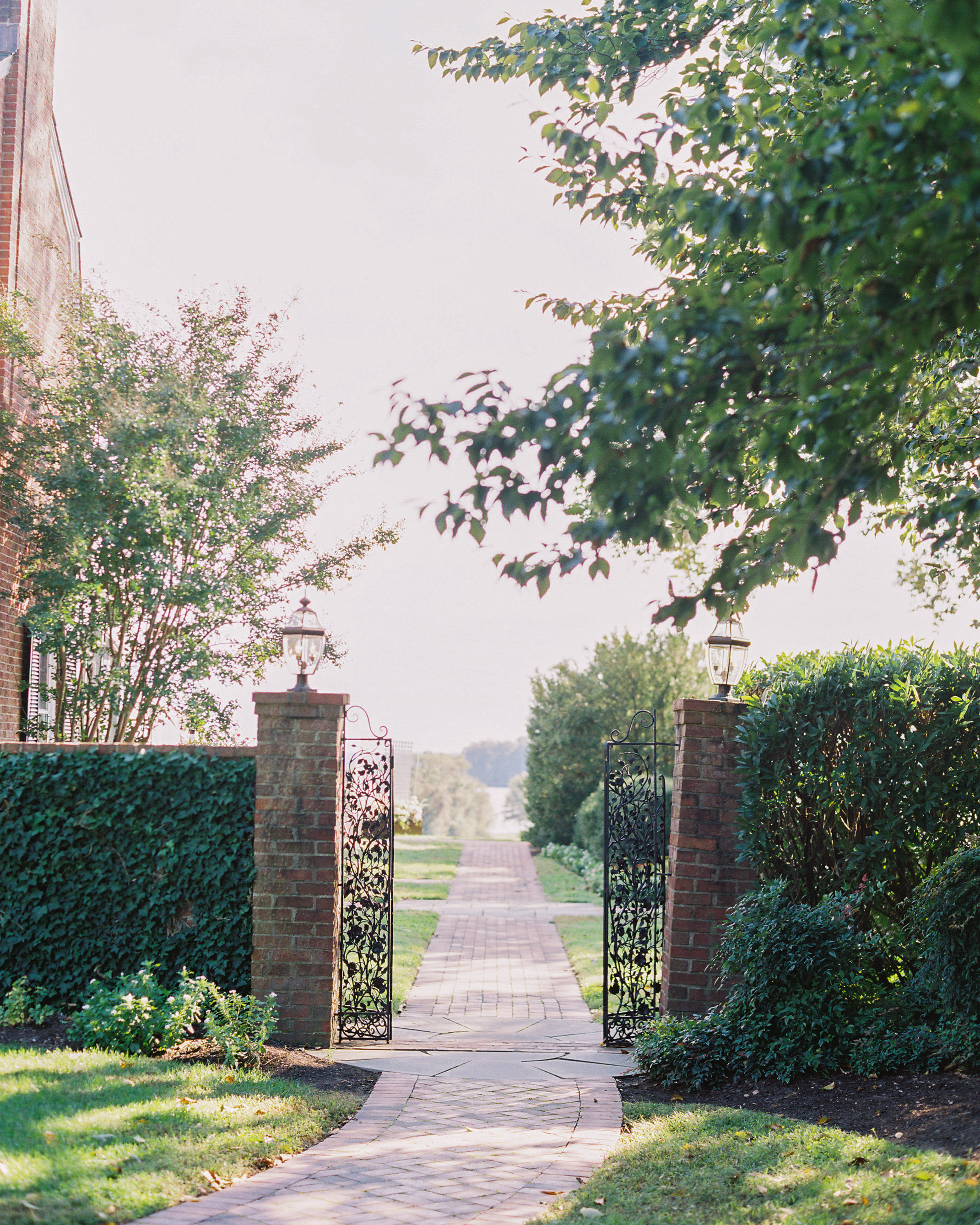 outdoor wedding venue gated entryway brick walkway