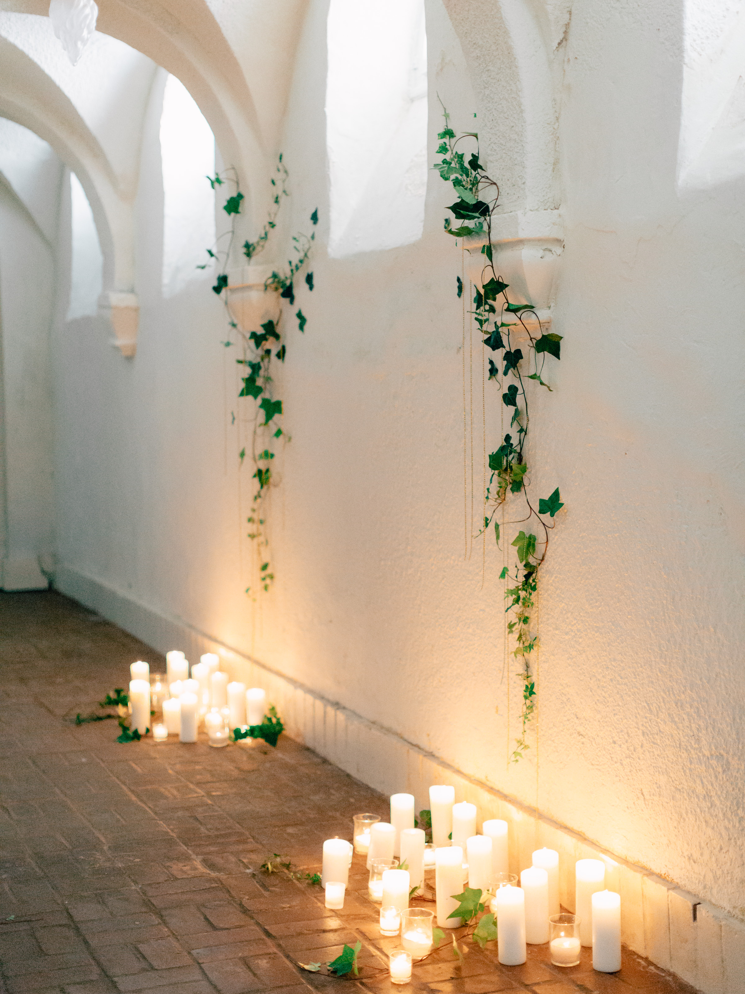 ceremony backdrop with candles and ivy