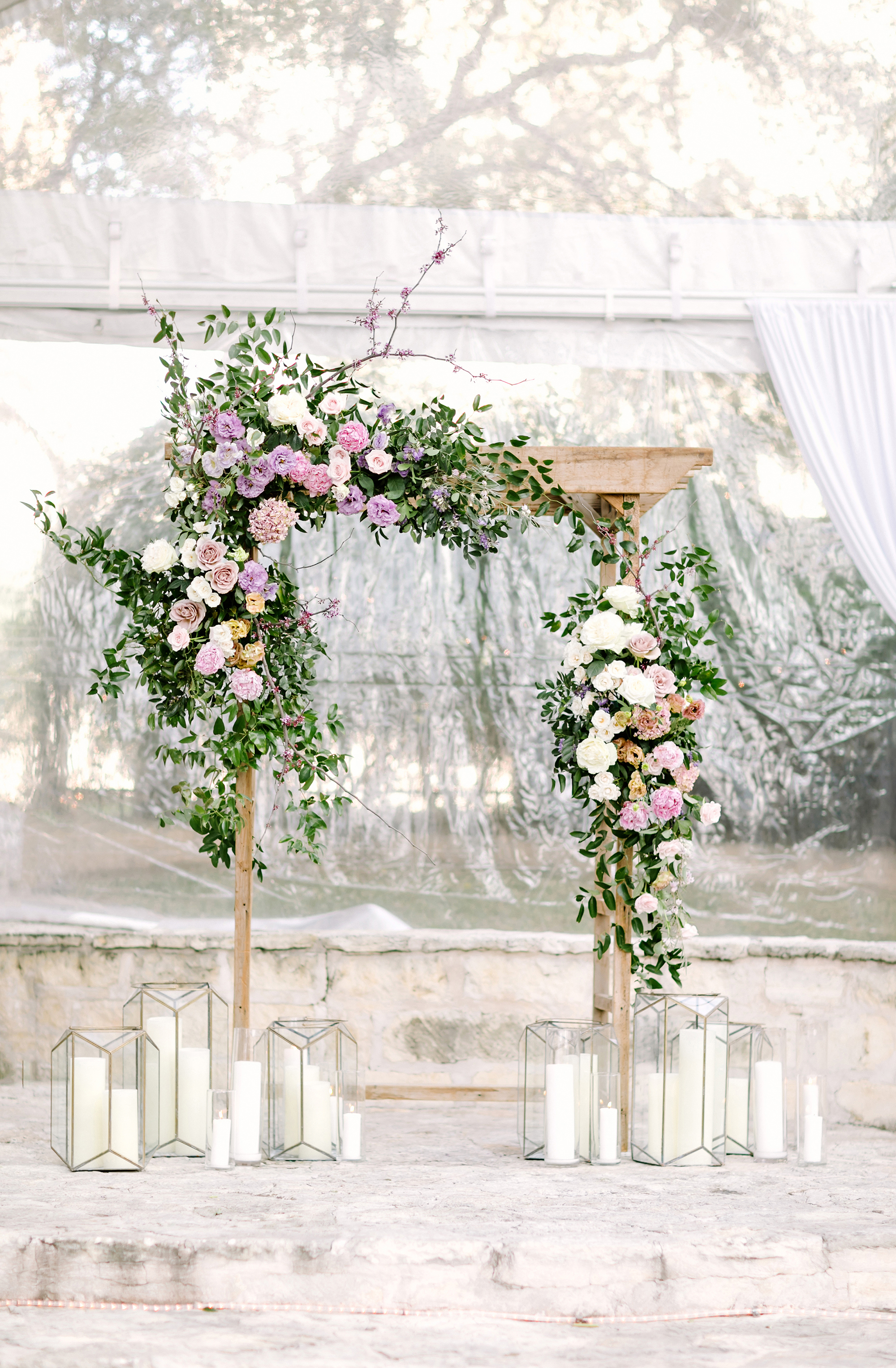 ceremony arch with florals greenery and candles
