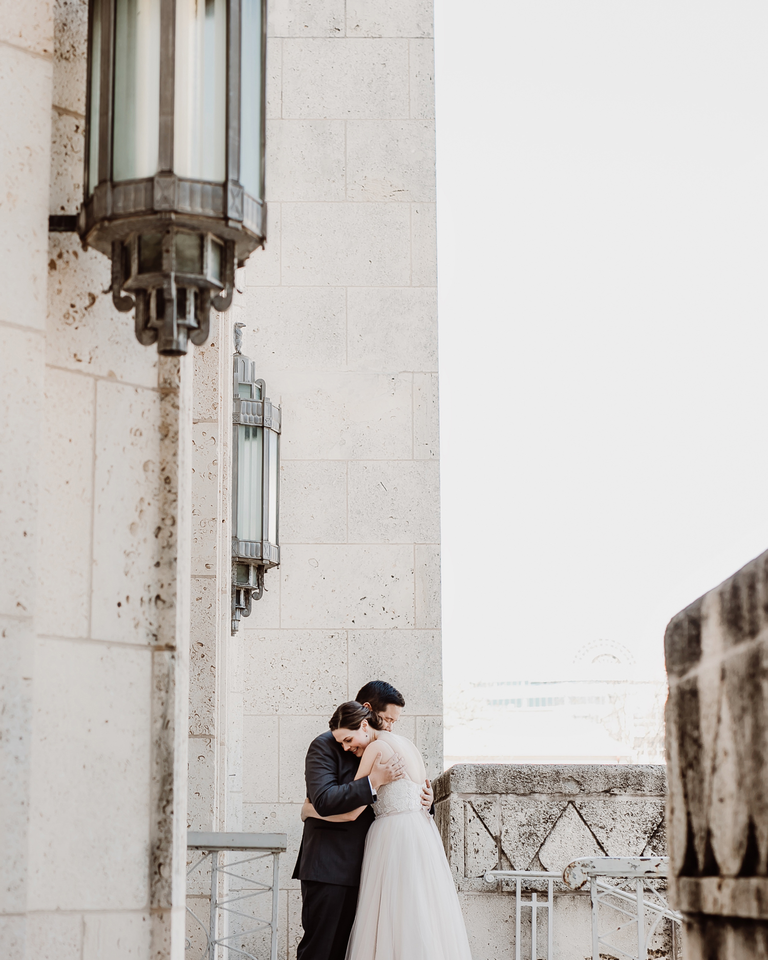 city hall wedding bride and groom hugging
