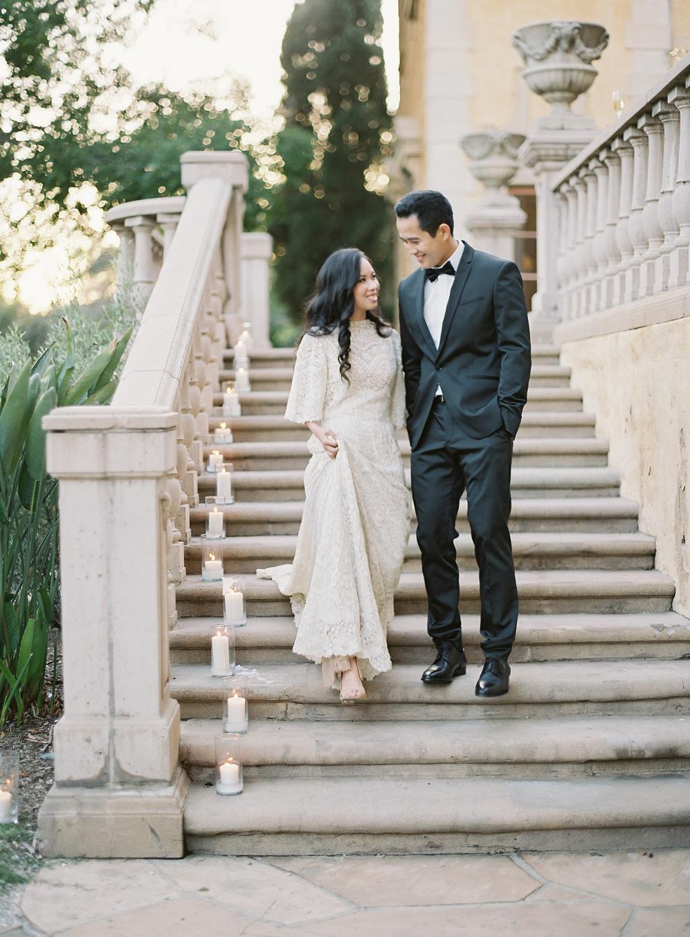 emme daji wedding couple walking down stairs