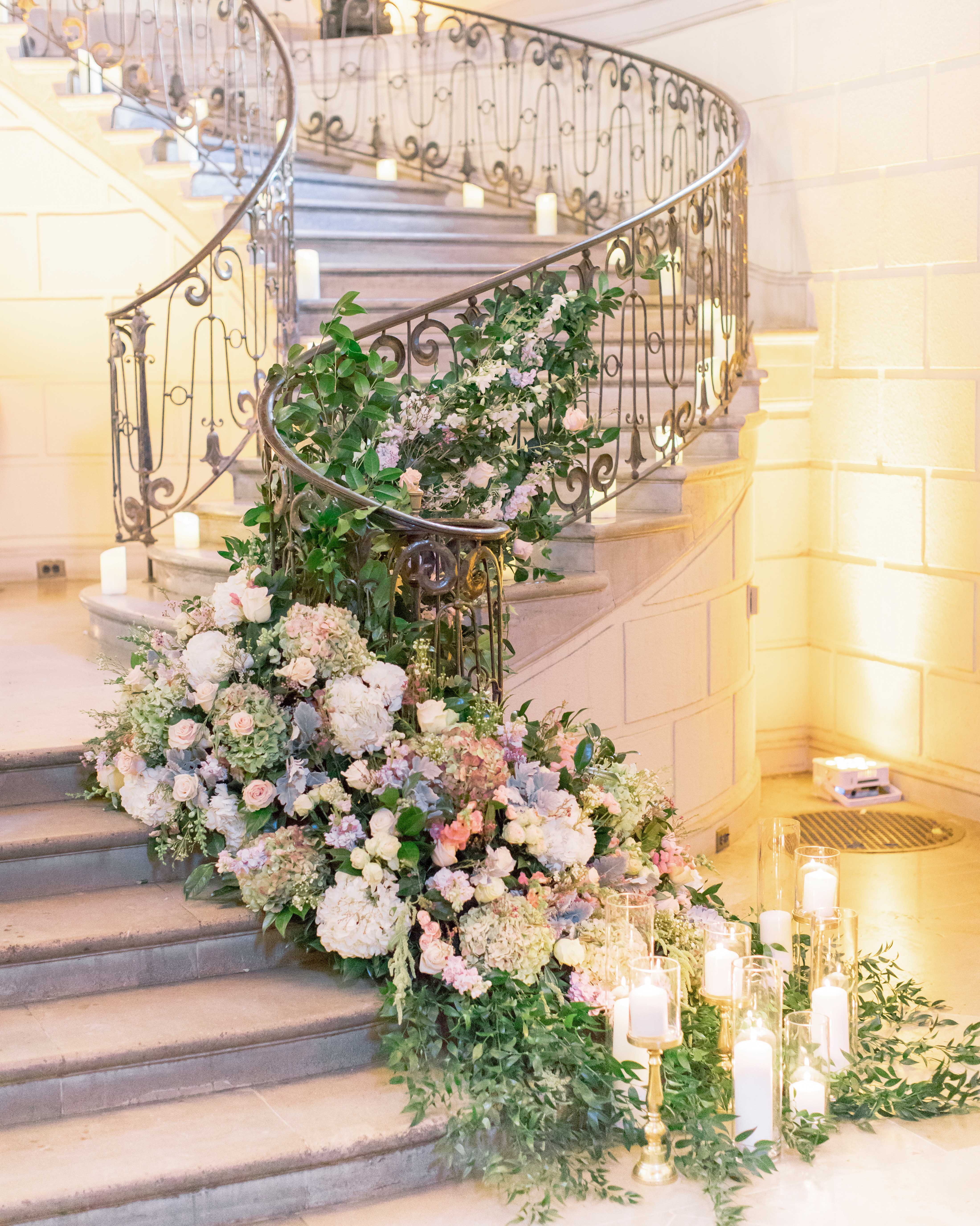 winding stair banister decor greenery hydrangea purple blooms