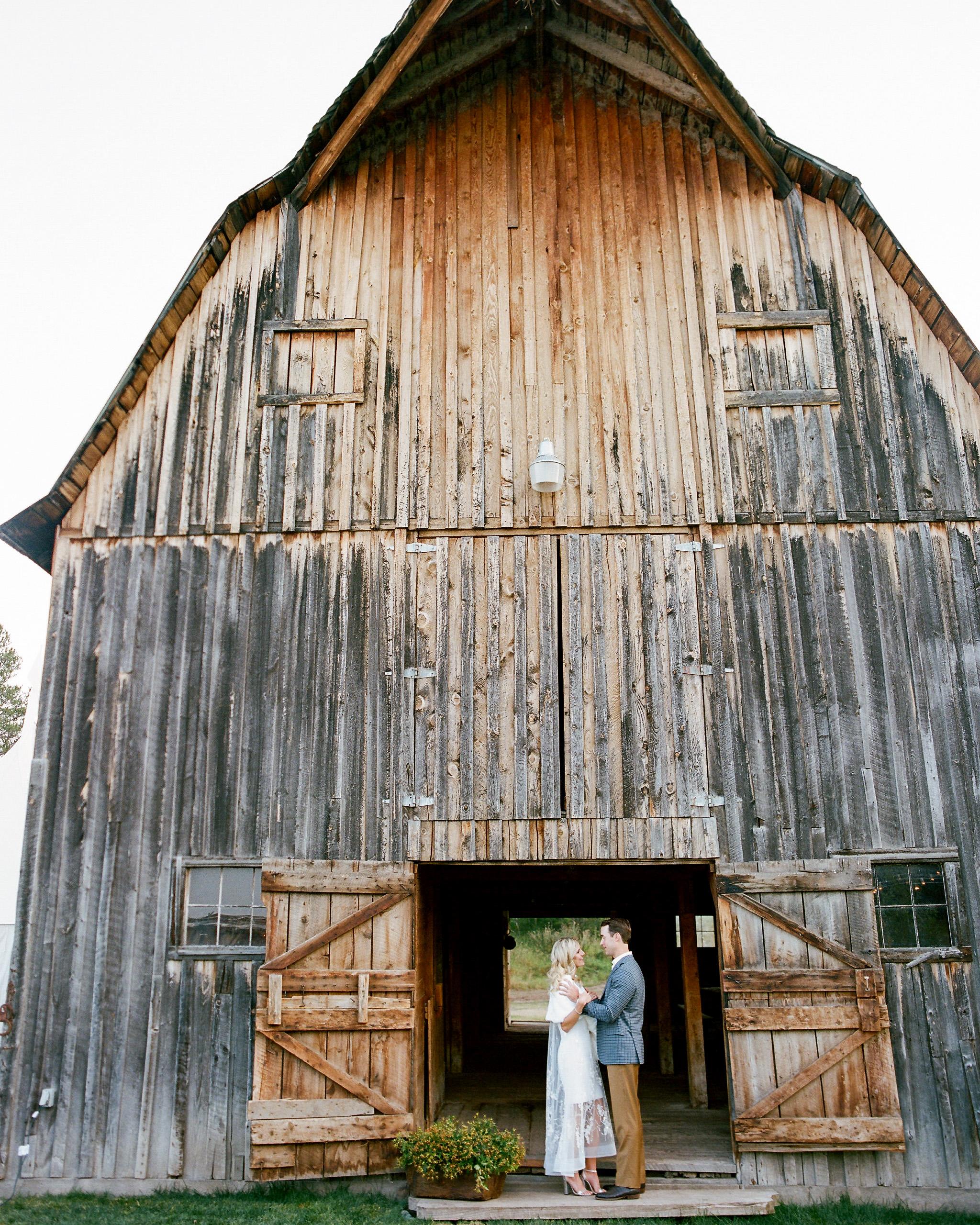 couple under barn doorway