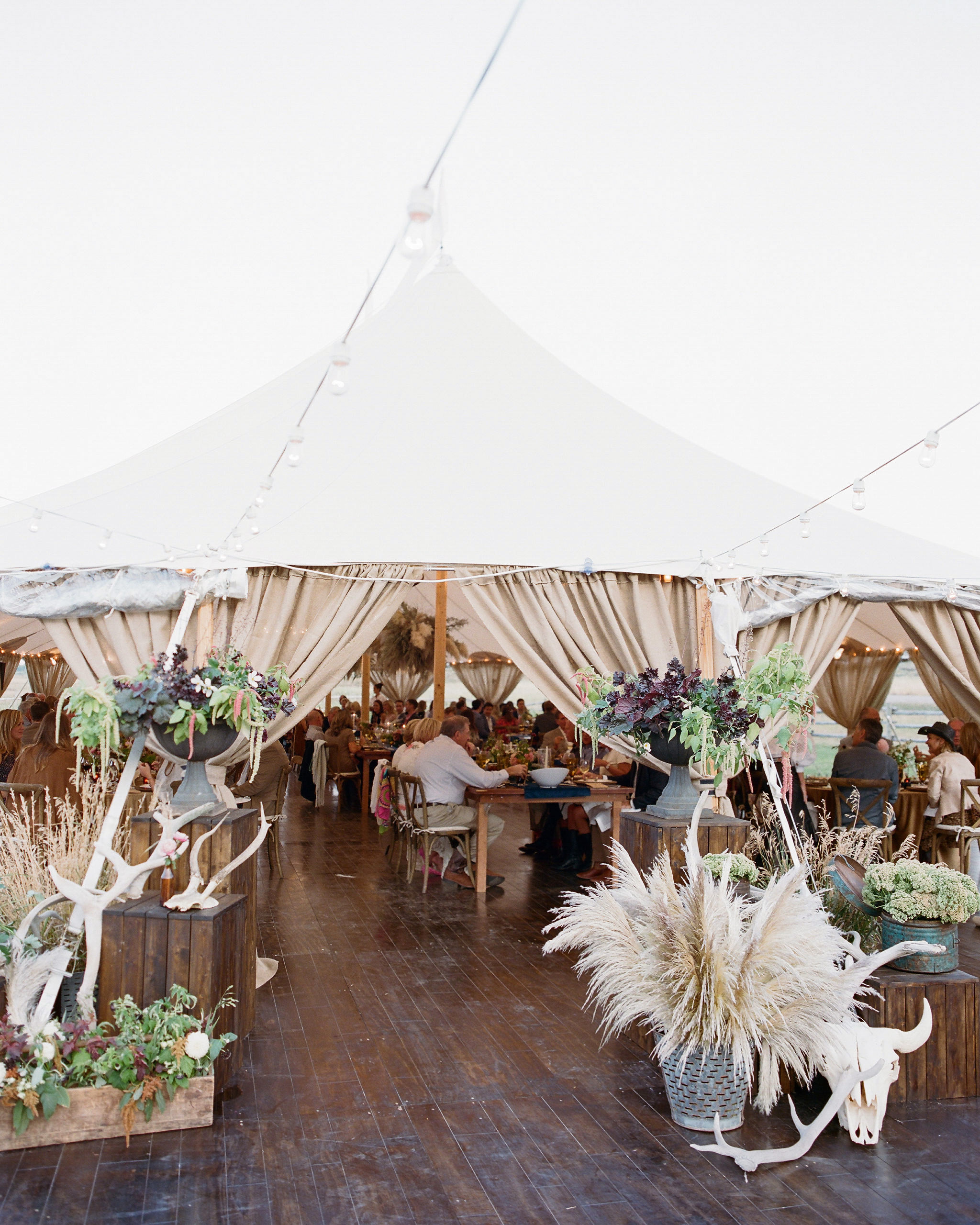 rehearsal dinner tent cover with wooden floor