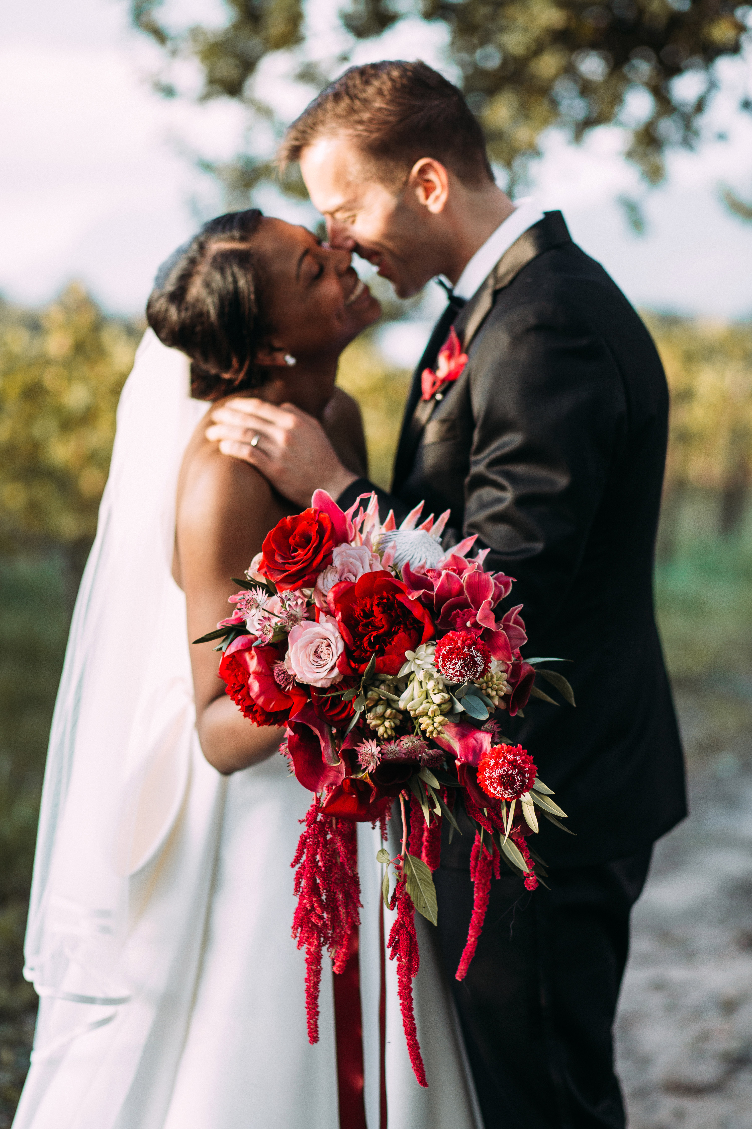 yolana douglas wedding couple kissing holding bouquet