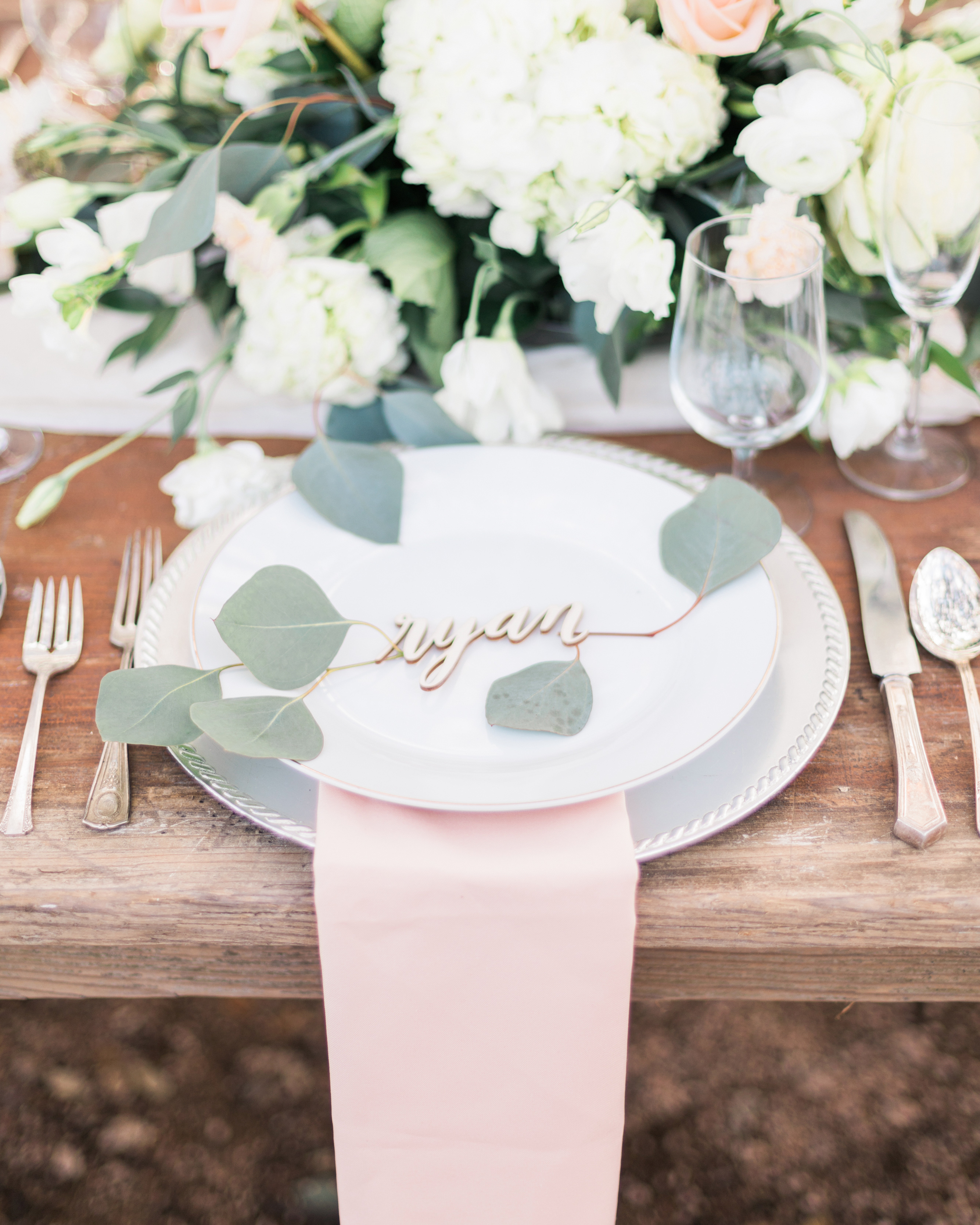 greenery to accent laser-cut place card table centerpiece