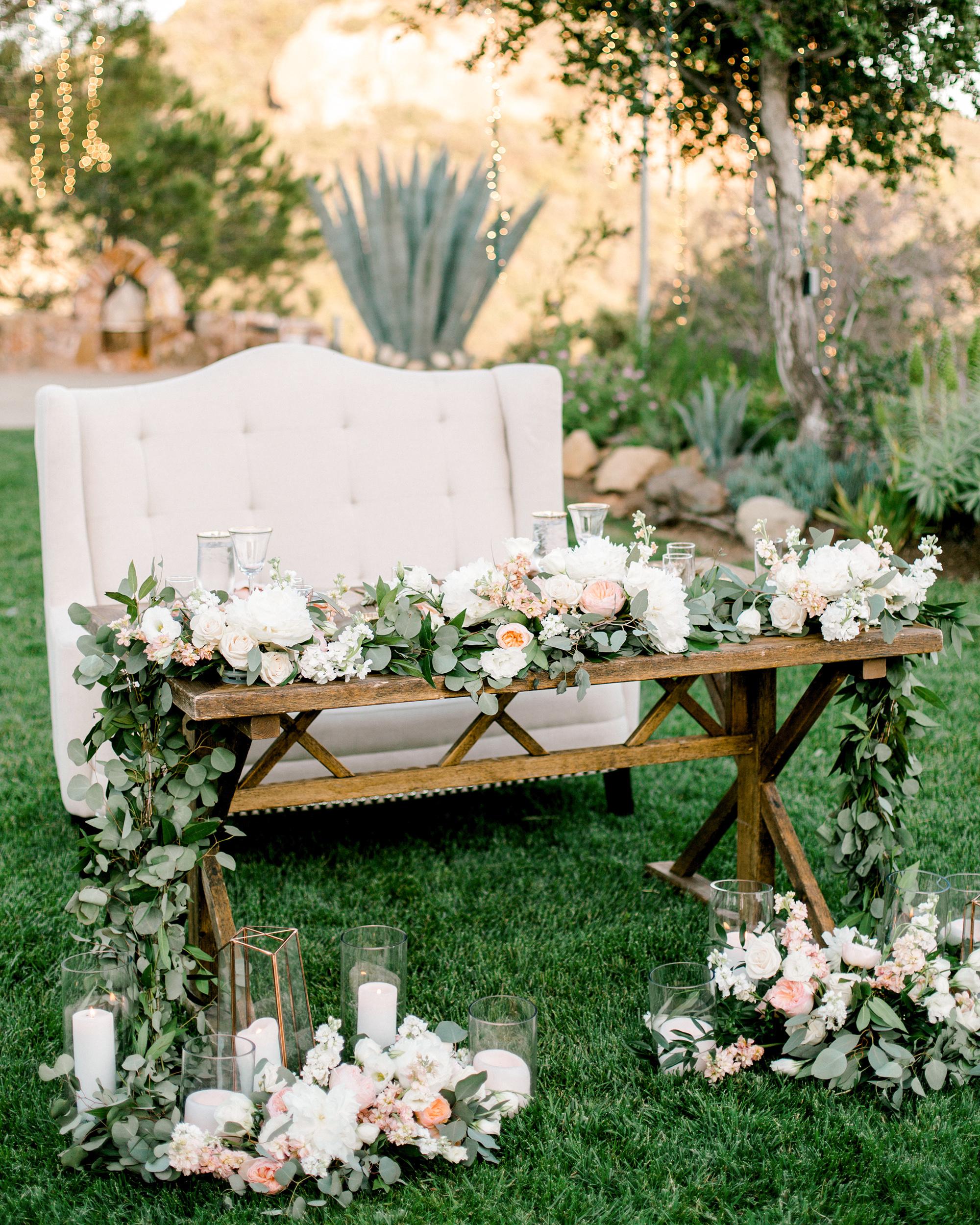 eucalyptus garland arrangement outdoor sweetheart table