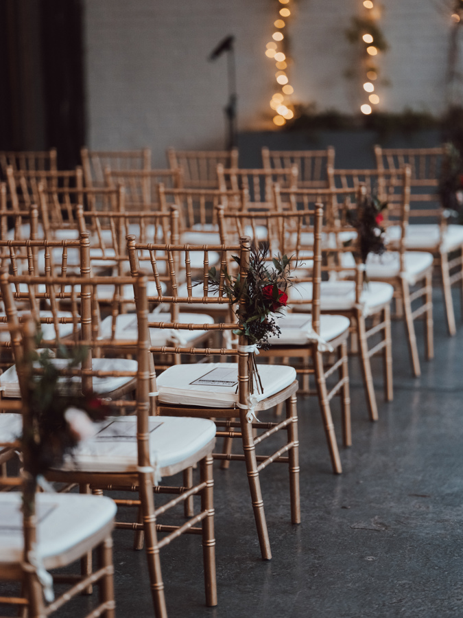 golden chairs with floral decor wedding seating