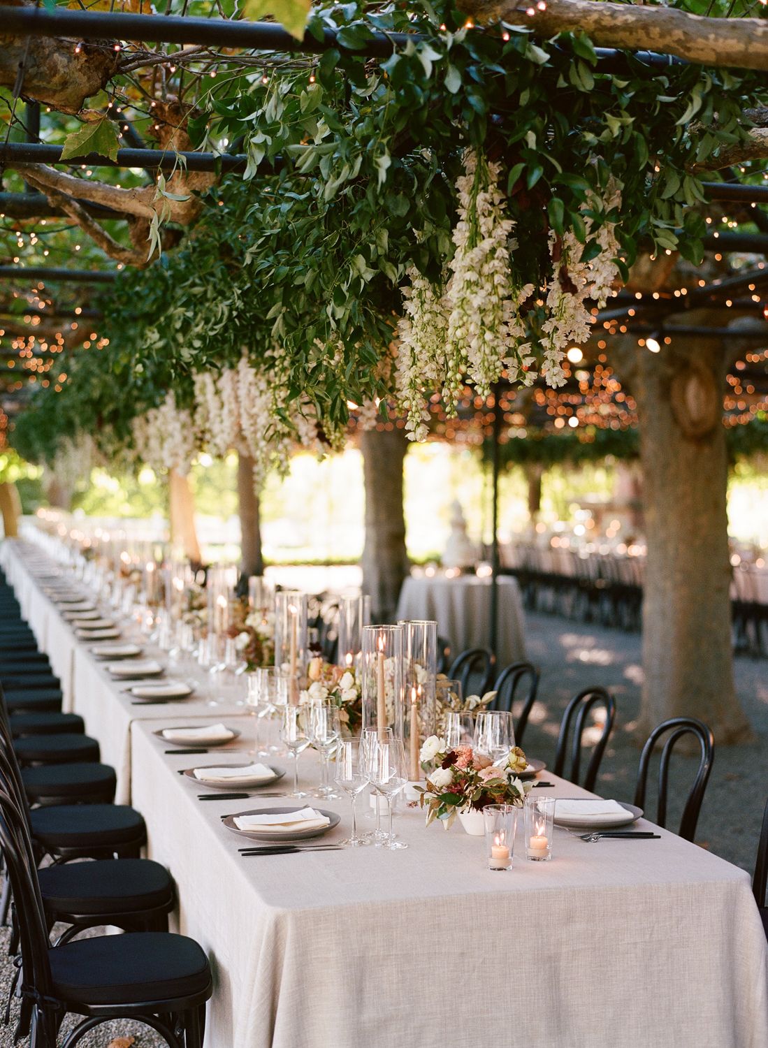 hanging floral decor above long reception table