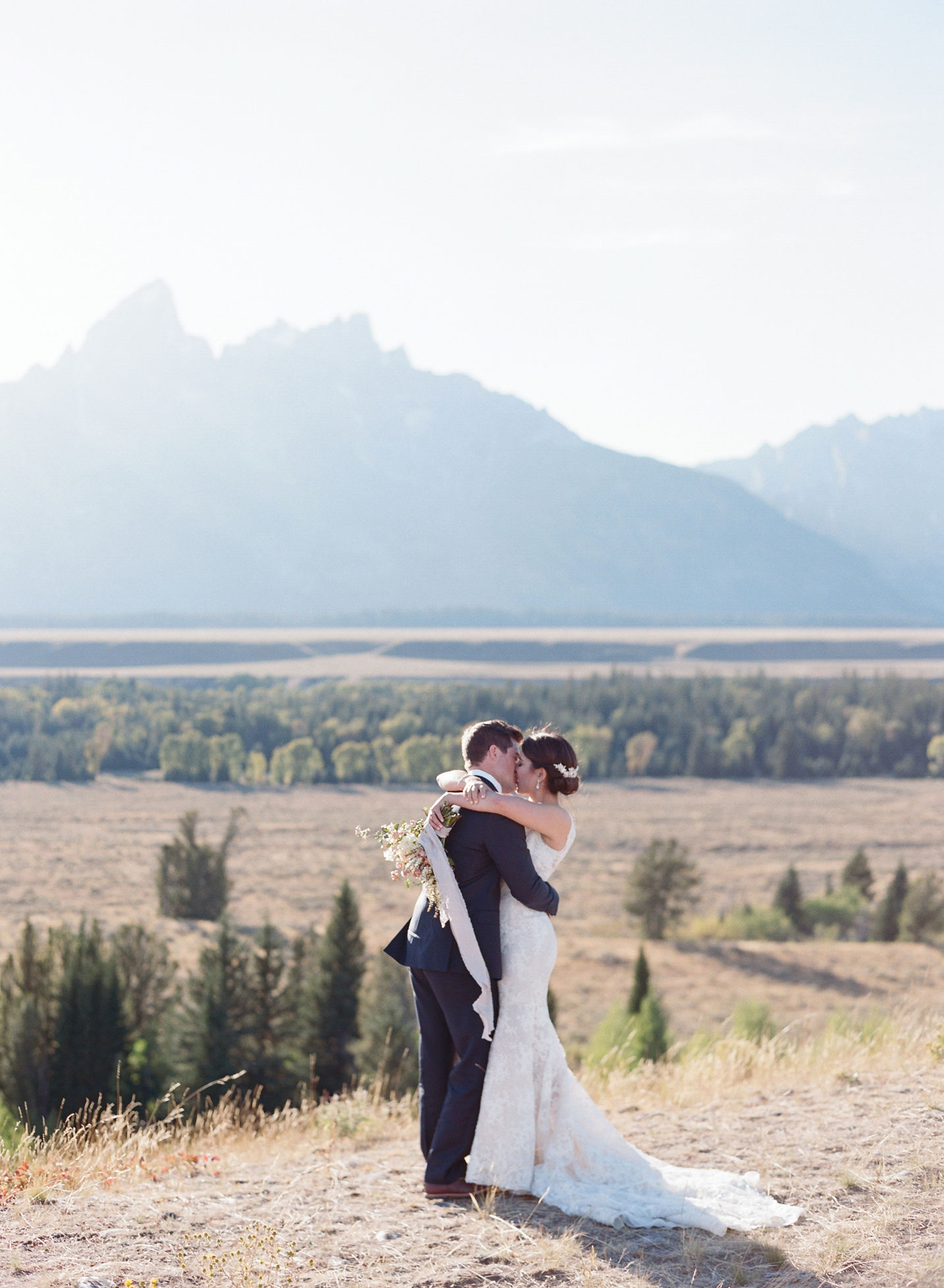 bride and groom holding each other jackson hole outdoors