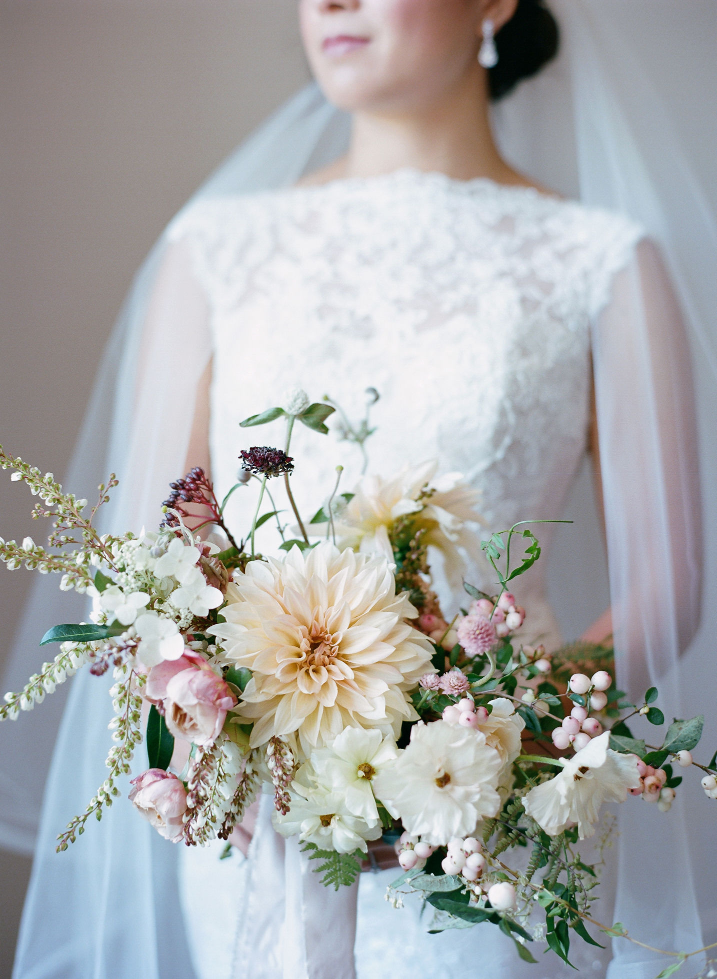 bride holding floral wedding bouquet