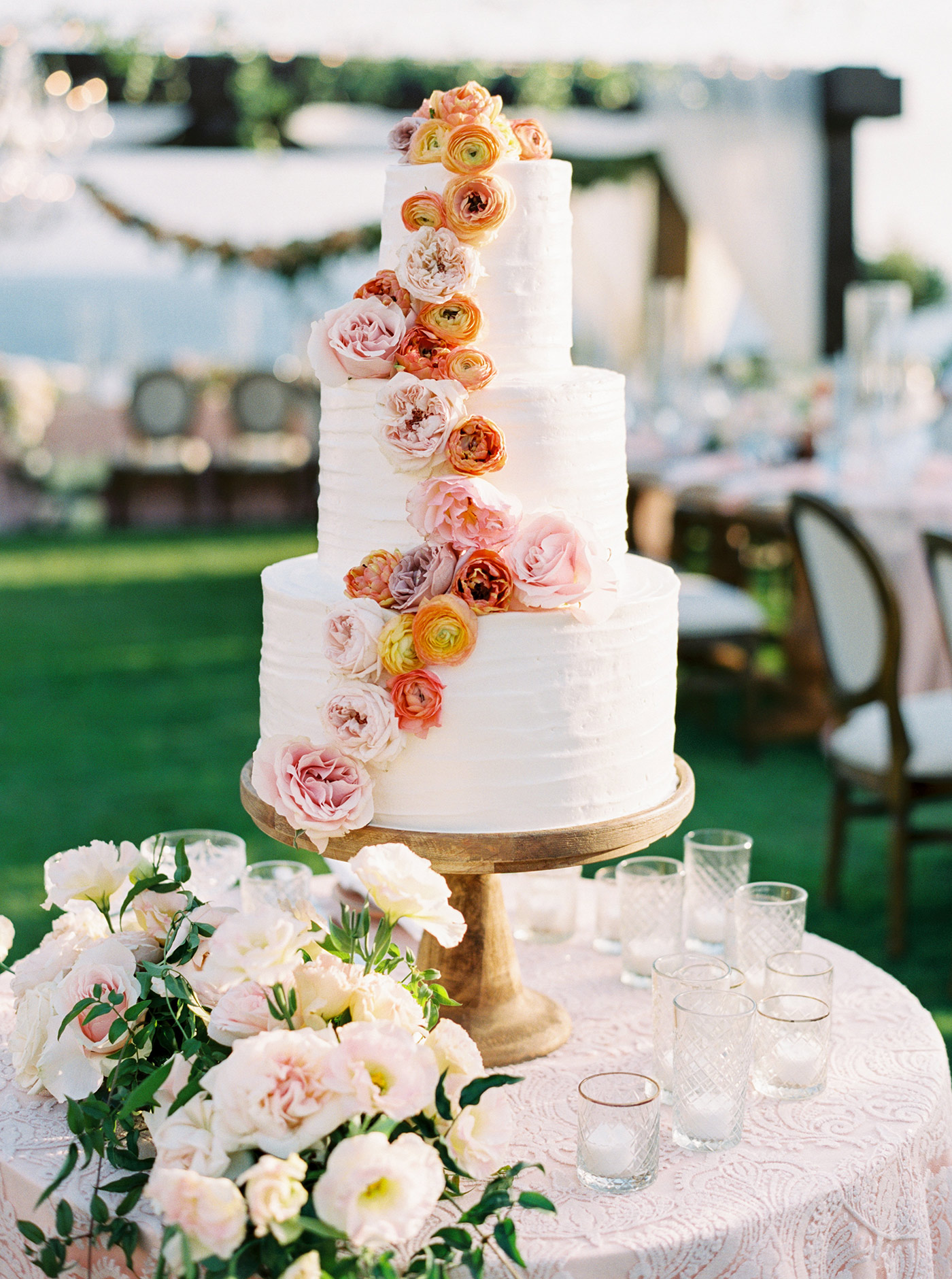 mykaela and brendon wedding white cake with cascading flowers