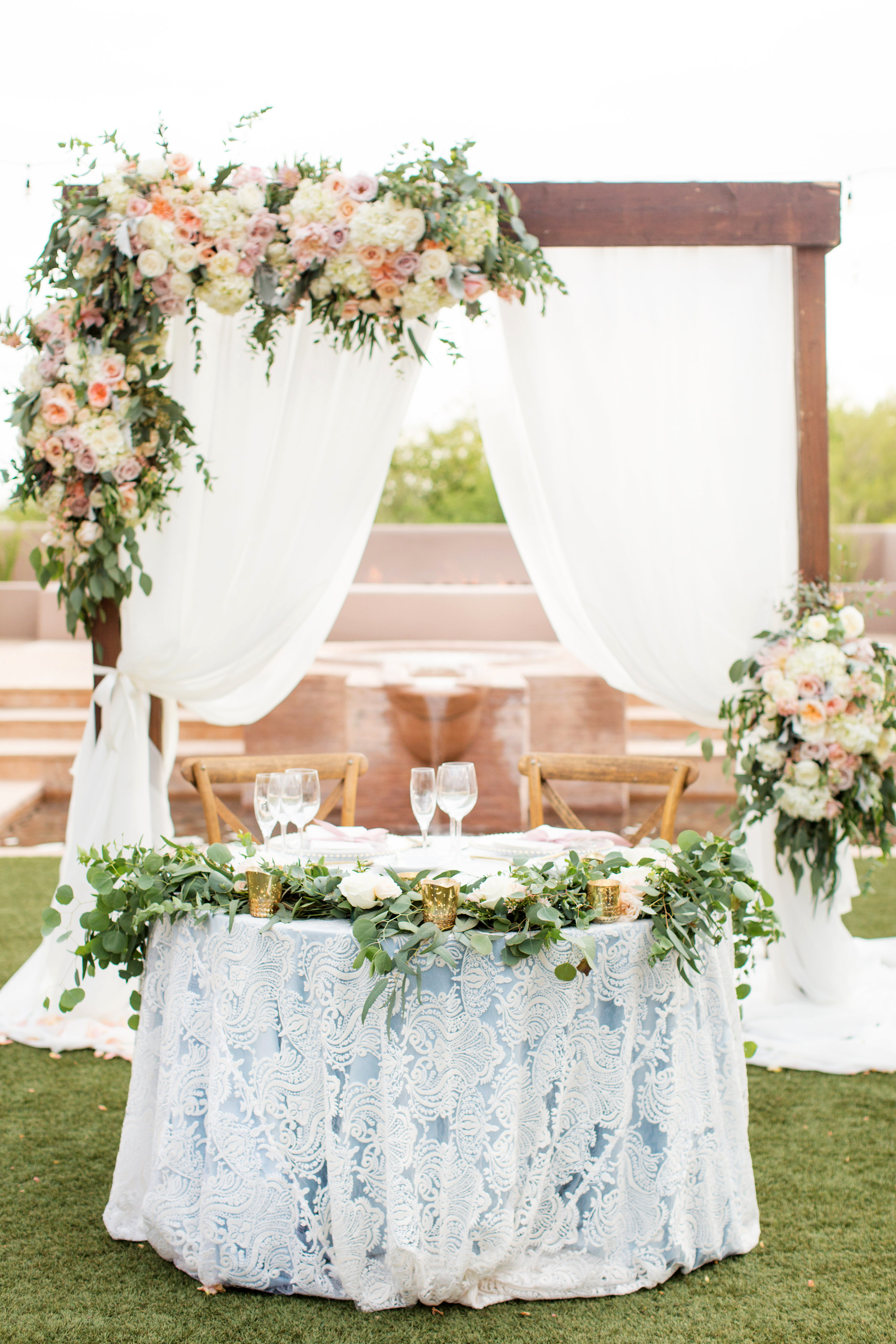 sweetheart table lace table and floral backdrop