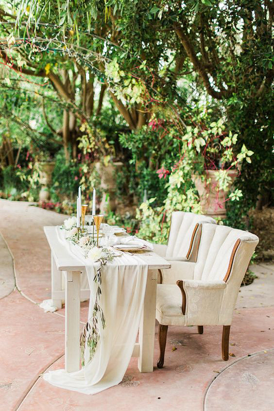 sweetheart table outdoor monochromatic white comfy chairs