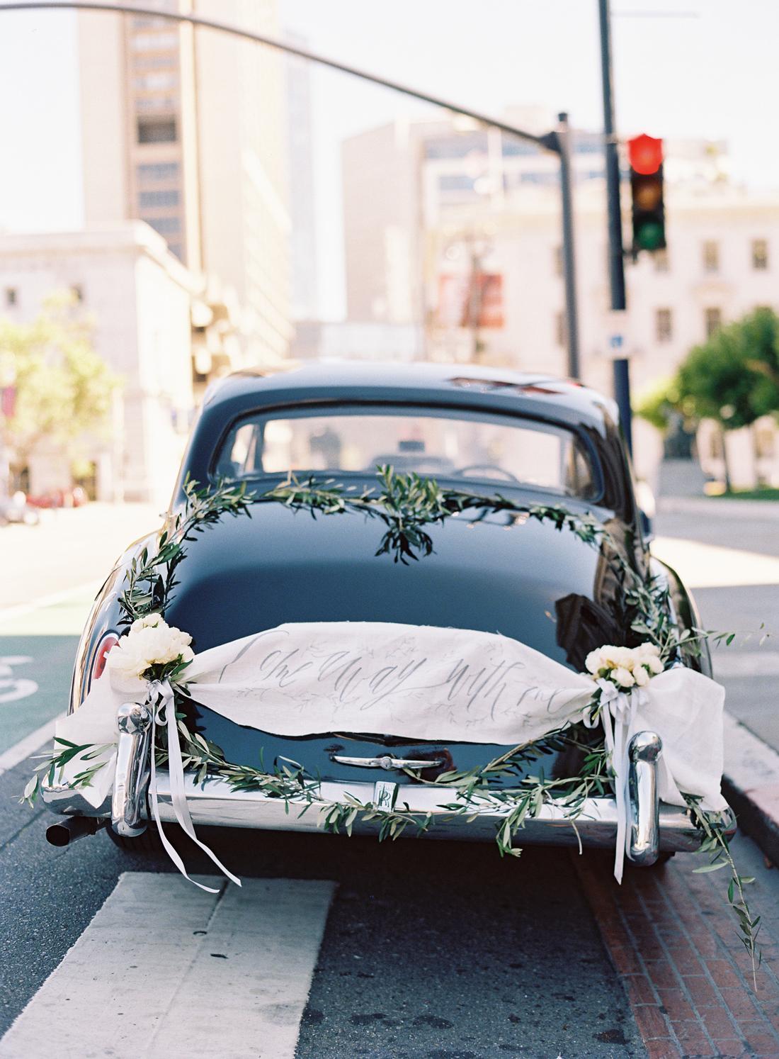 black vintage wedding day getaway car