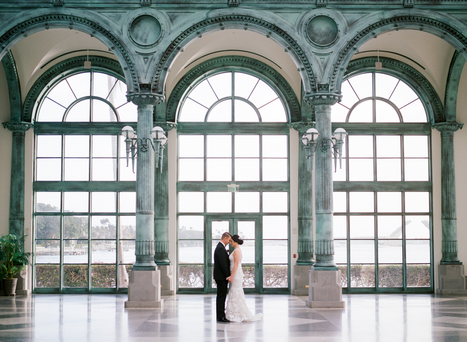 city hall wedding bride and groom in front of windows