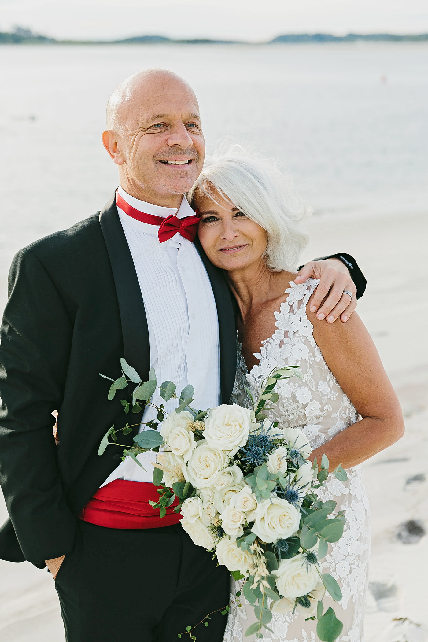 middle-aged bride and groom on beach