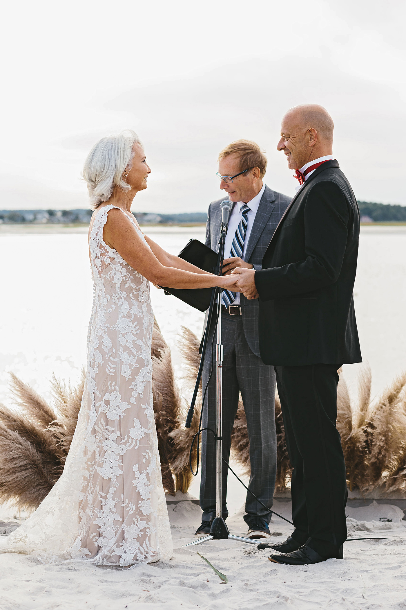 beachfront ceremony with pampas grass