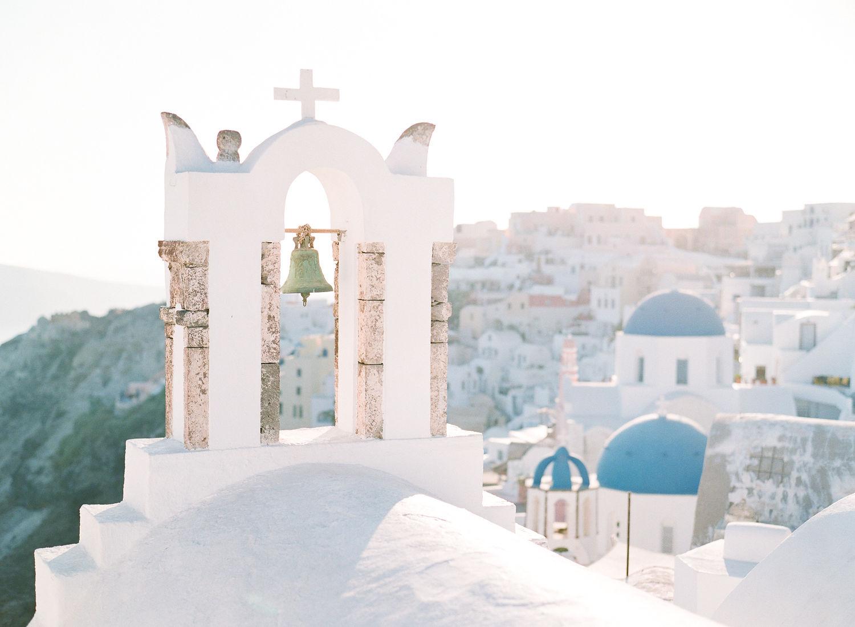 cross topped arch in Santorini Greece
