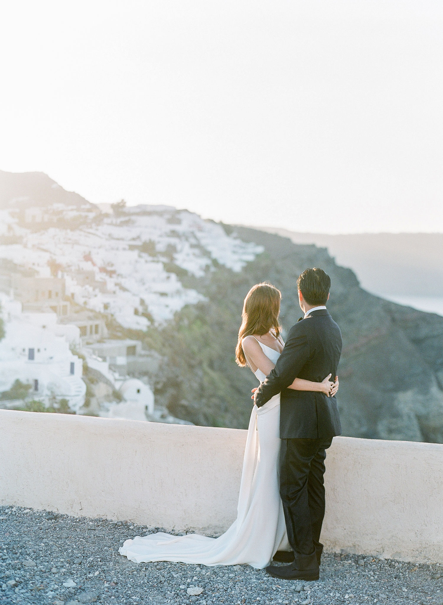 bride and groom overlooking greek coast