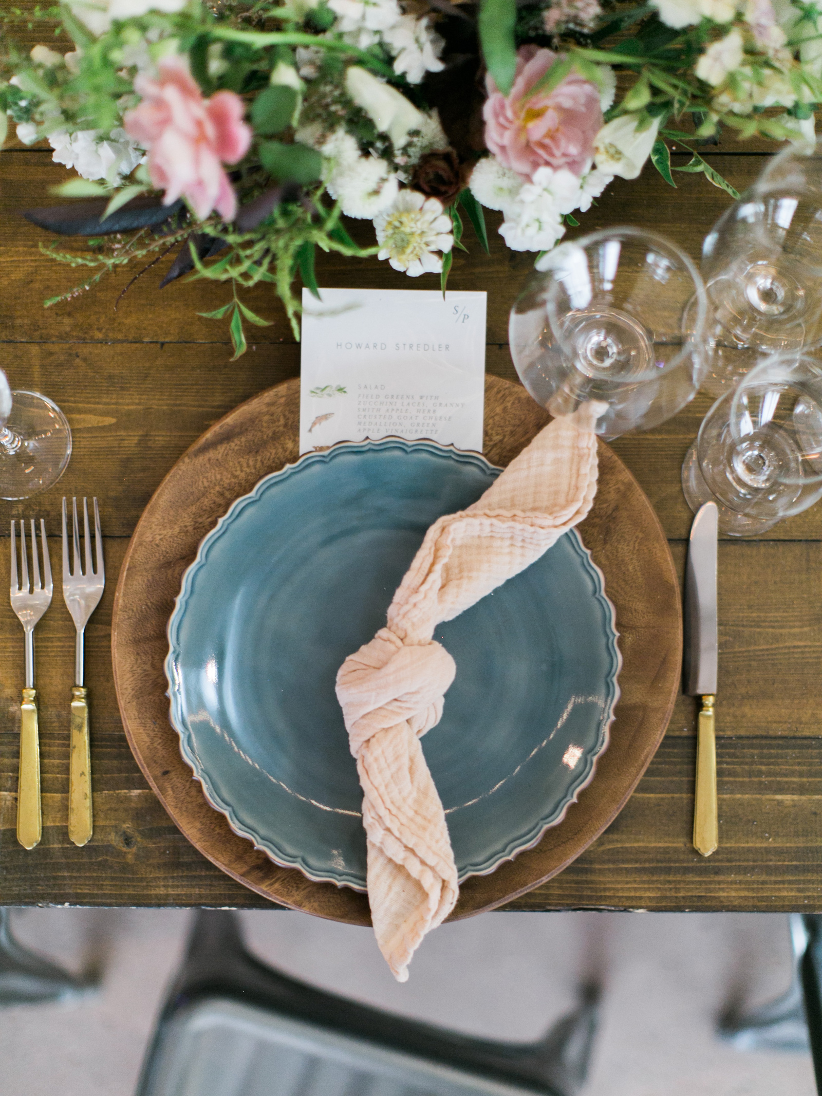 turquoise and brown hued table settings with floral centerpieces