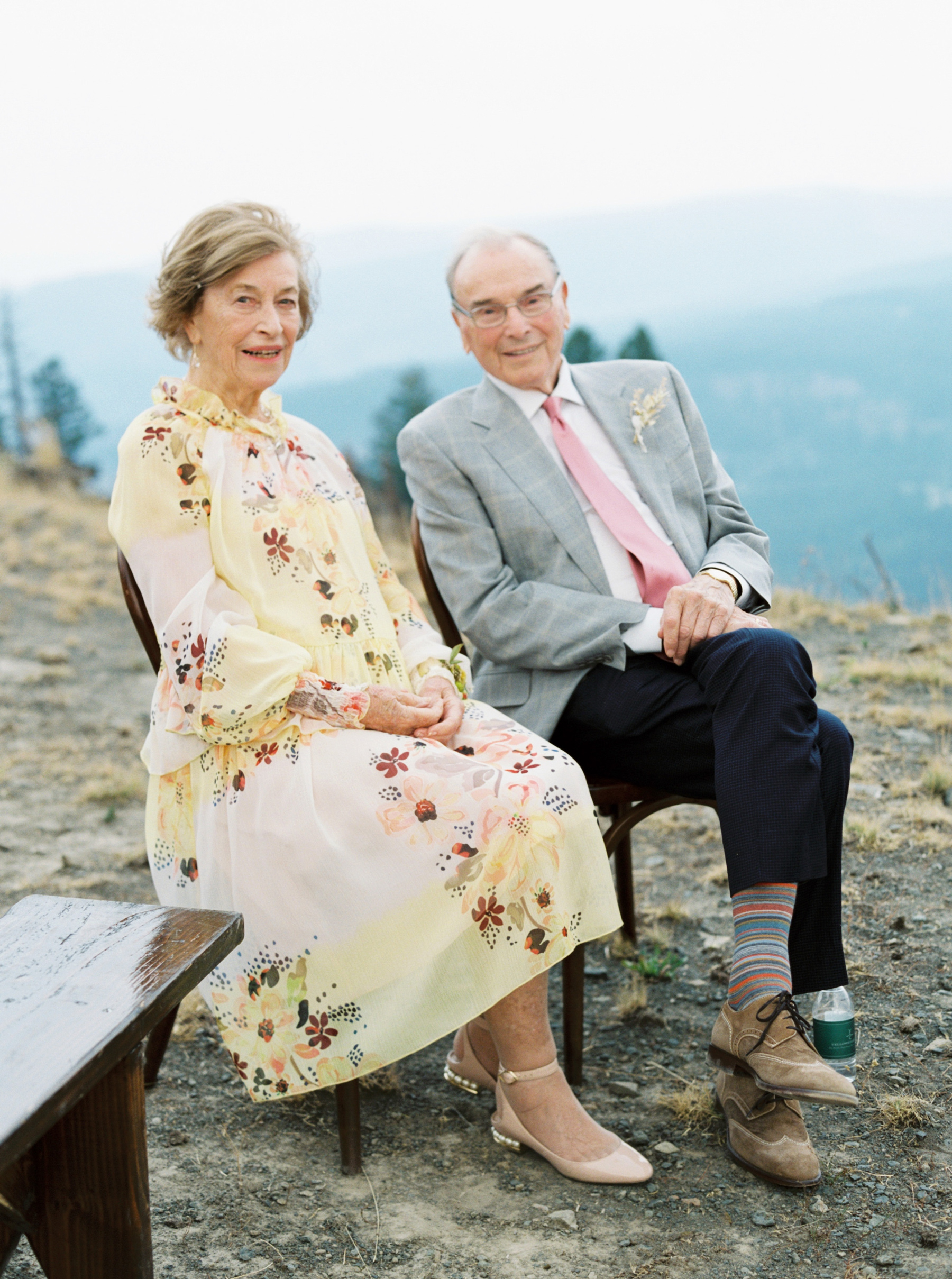 bride's grandparents sitting on wooden chairs