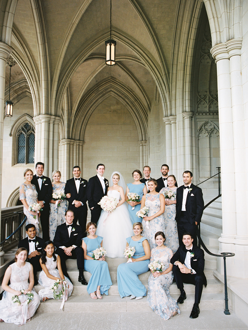 bride and groom with bridal party at wedding venue