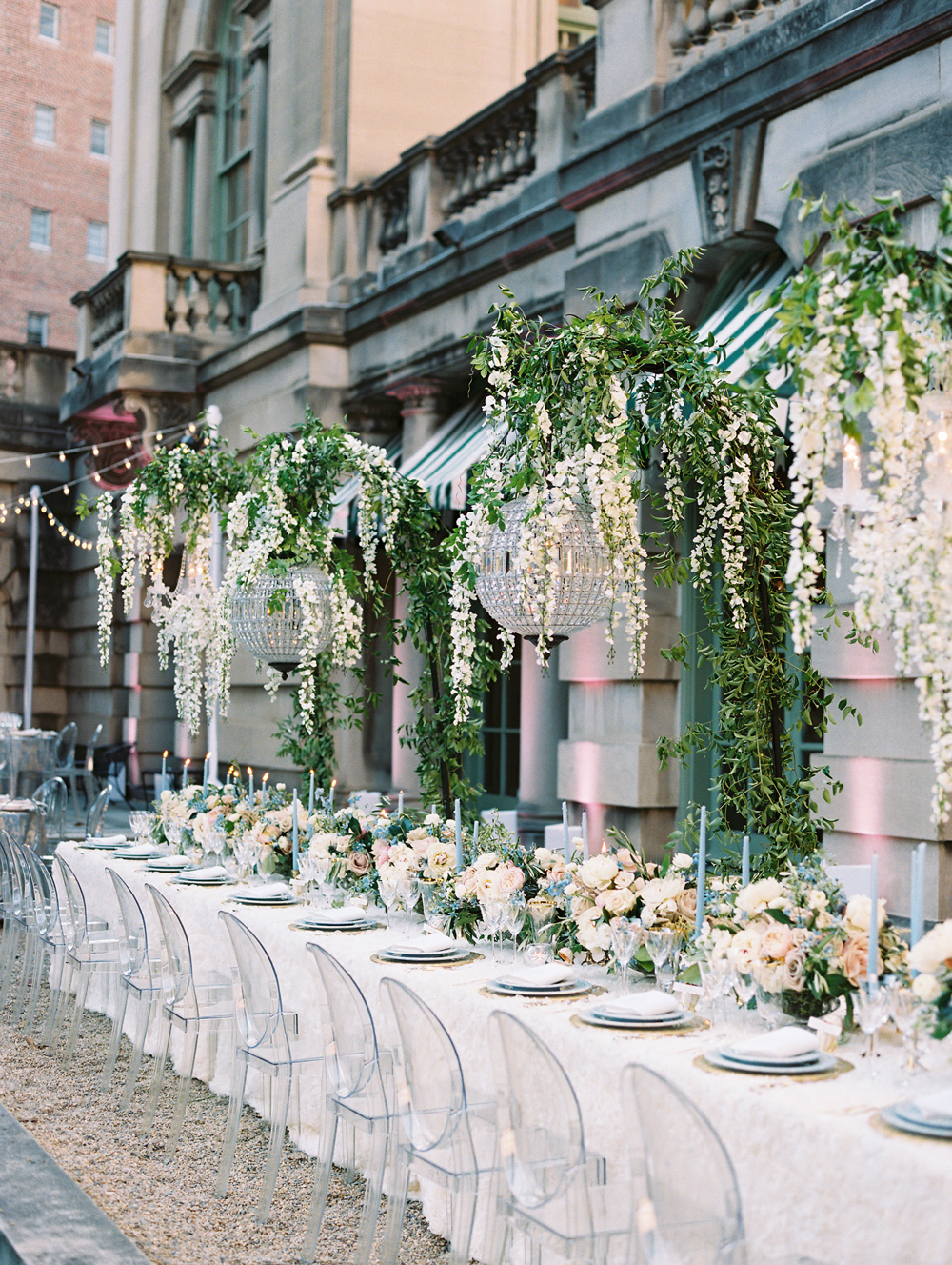 long wedding reception tables with hanging floral displays