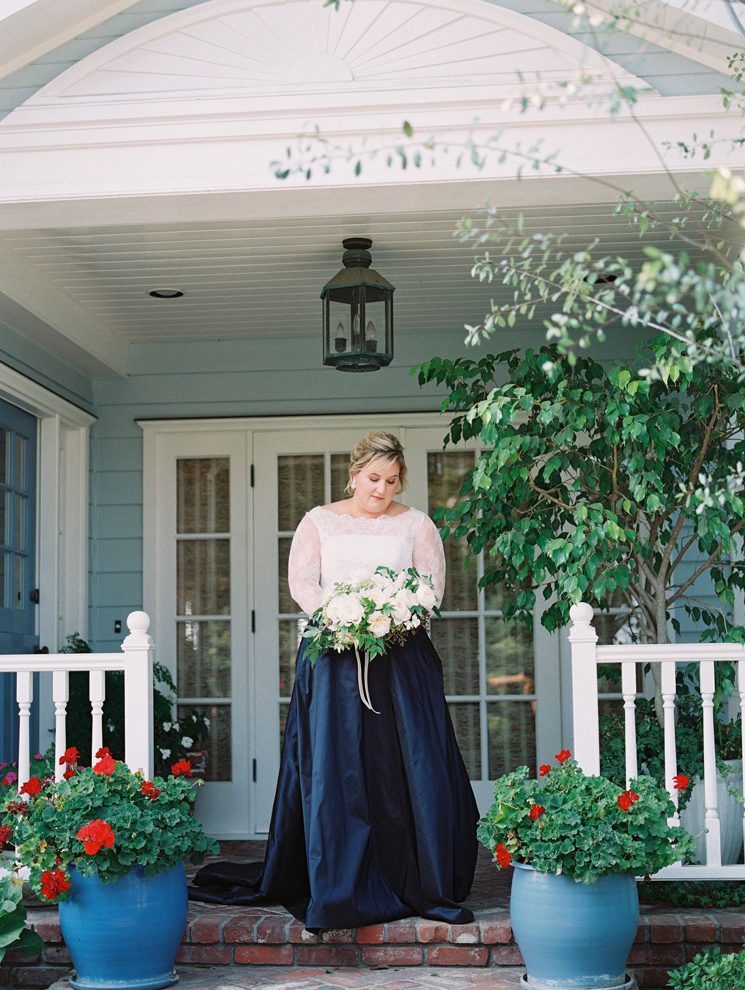 elizabeth scott wedding bride standing on porch
