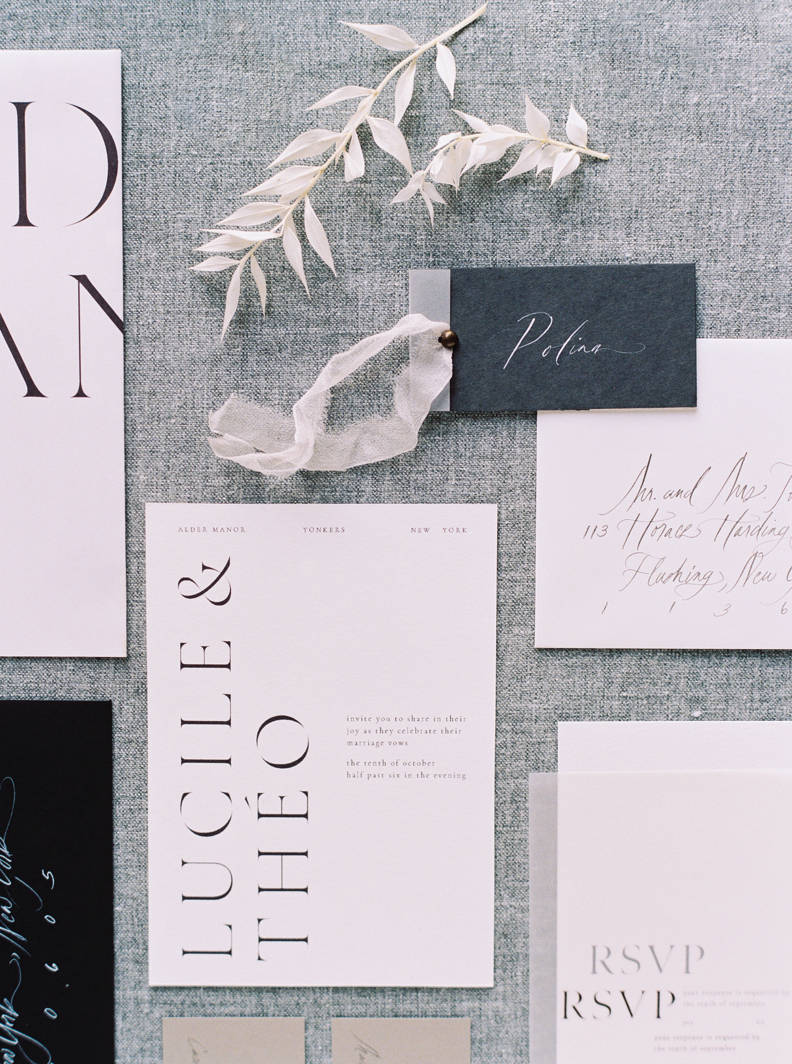 wedding invitation negative space bold capitalized names